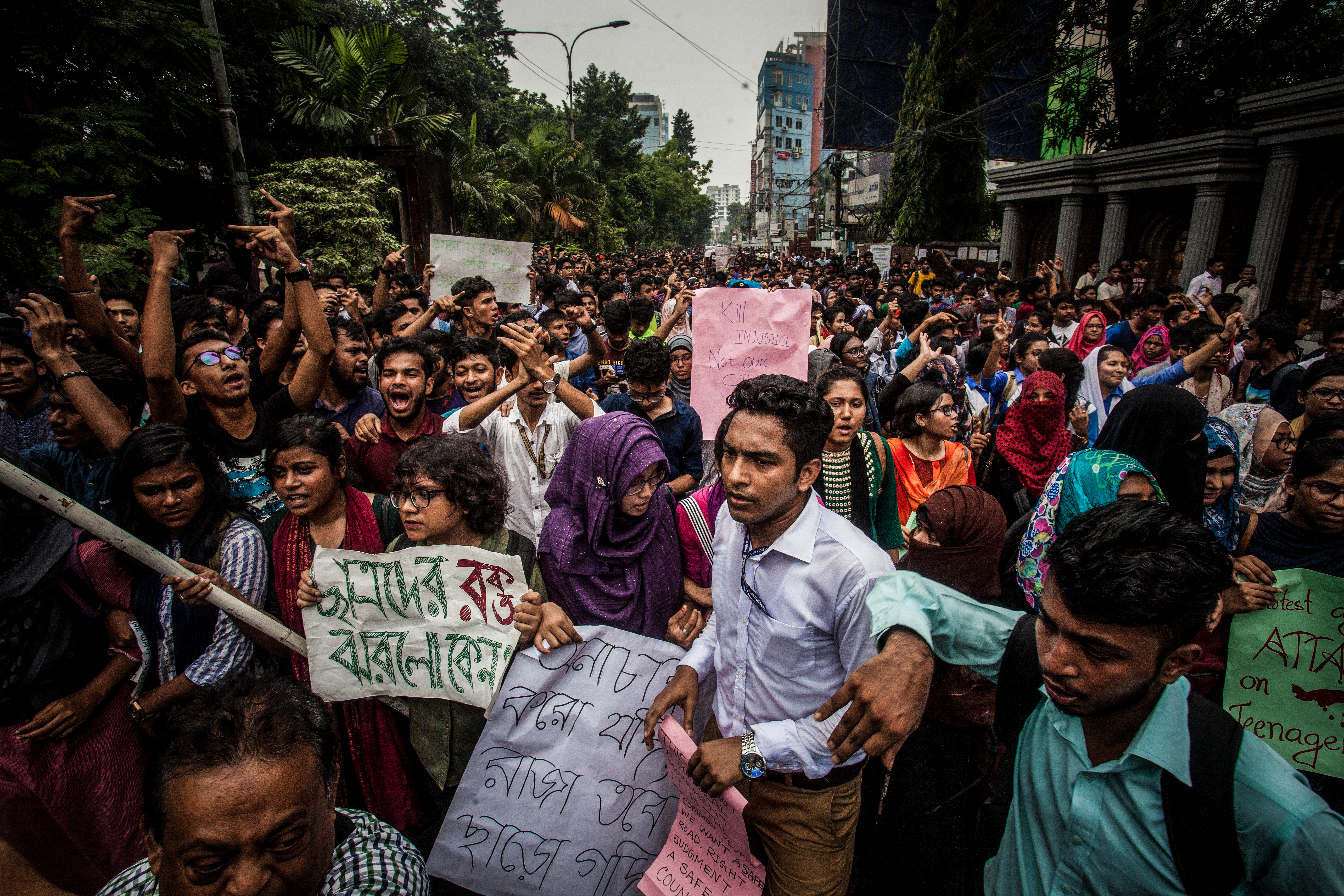 Bangladeshi students march along a street during a student protest in Dhaka on Aug. 5, 2018, following the deaths of two college students in a road accident.