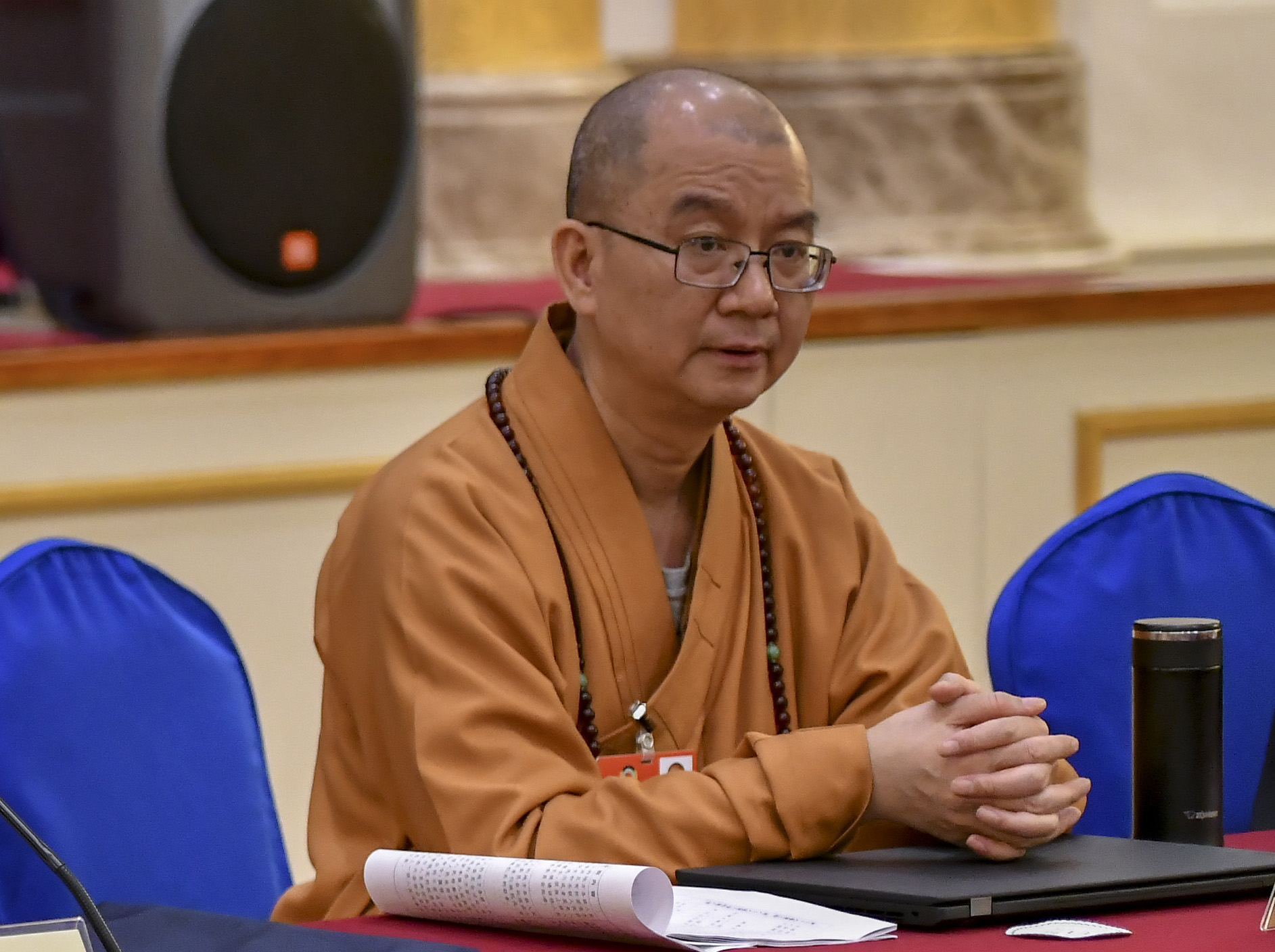 Xuecheng, abbot of Longquan Temple, attends a panel discussion in Beijing on March 7, 2018.