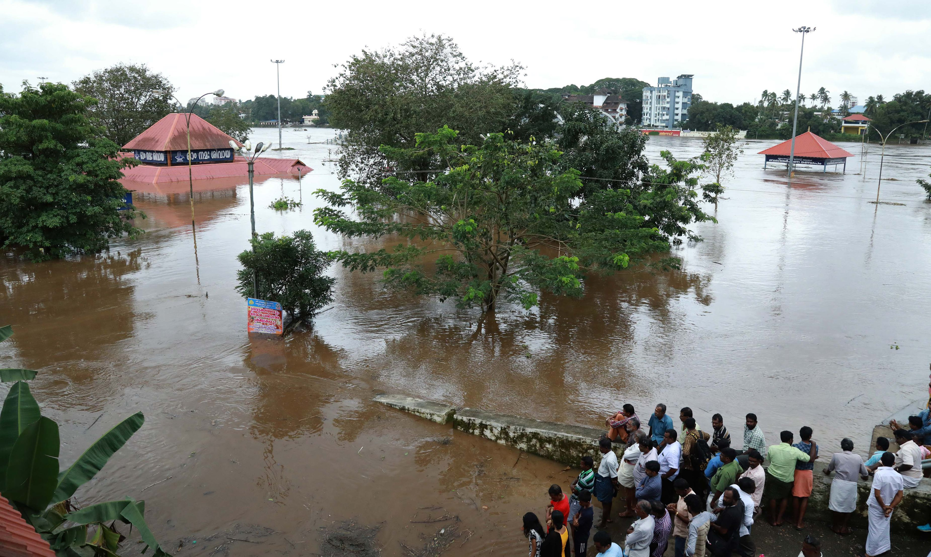 Indian residents look at the Shiva Temple submerged after the release of water from Idamalayar dam following heavy rains in Kochi on Aug. 9, 2018.