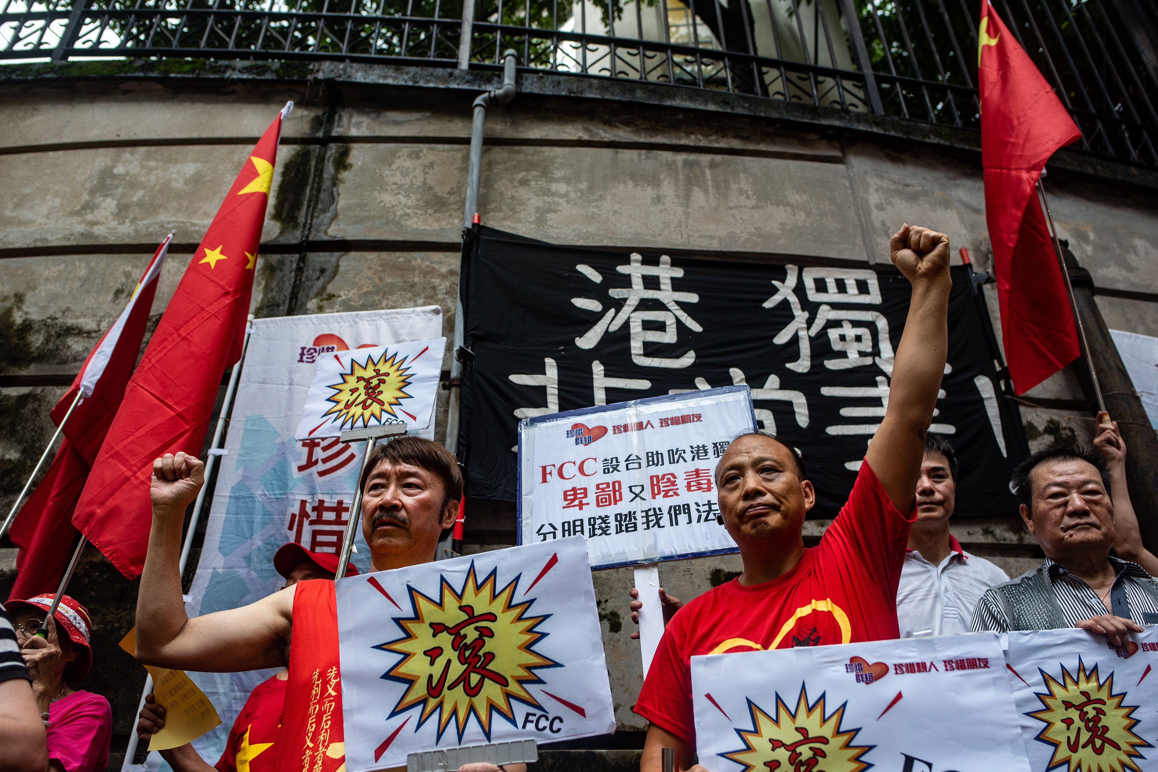 Pro-Beijing protesters chant slogans against pro-independence activist Andy Chan, who is scheduled to make a speech at the Foreign Correspondents' Club (FCC), in Hong Kong on August 14, 2018.