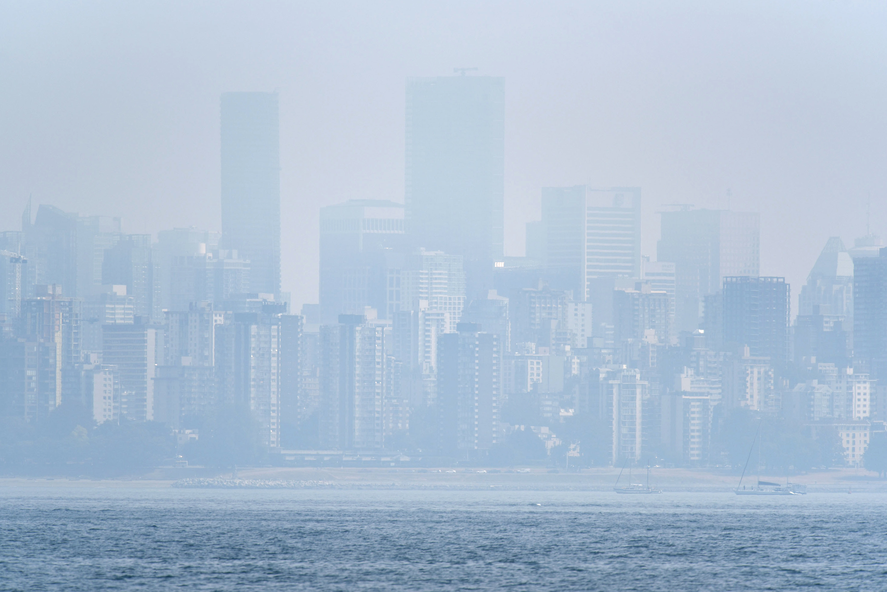 This photo shows the Vancouver skyline under heavy haze as seen from Jericho Beach on Aug. 21, 2018.