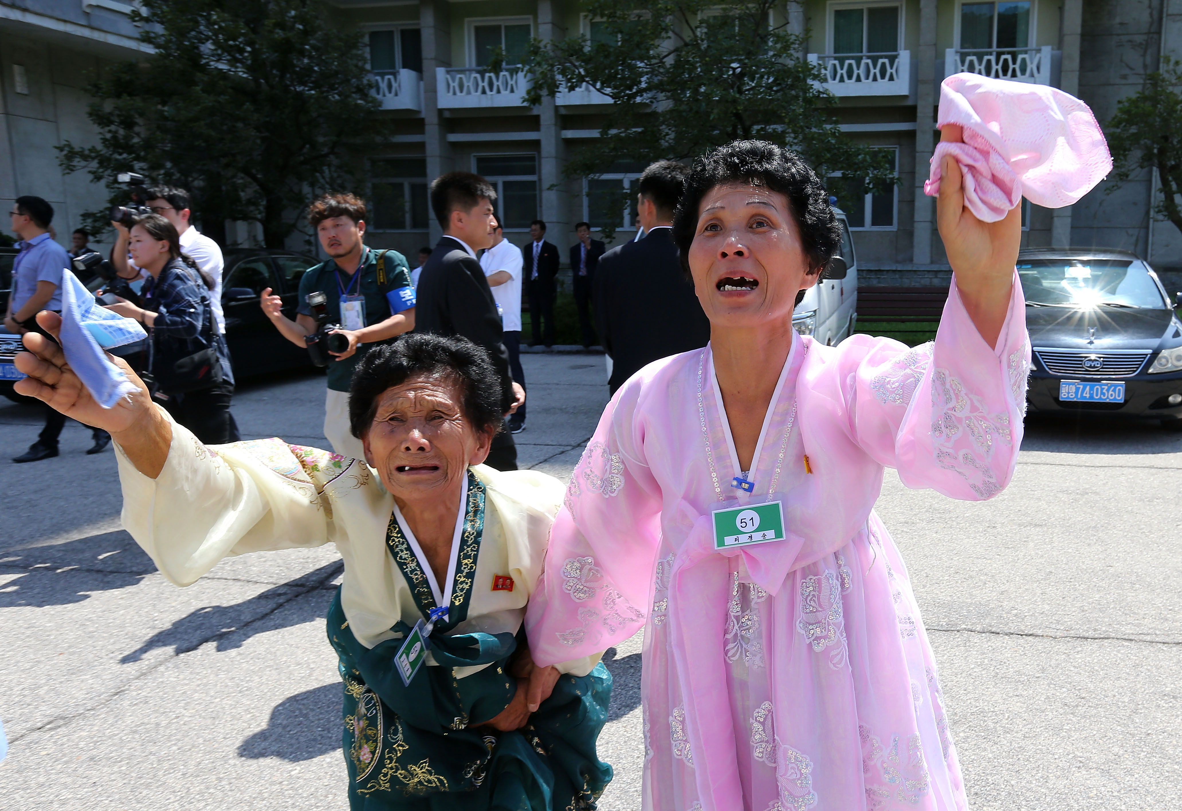 North Koreans wave to their South Korean family returning home after a separated family reunion meeting at in Mount Kumgang, North Korea on Aug. 22, 2018.
