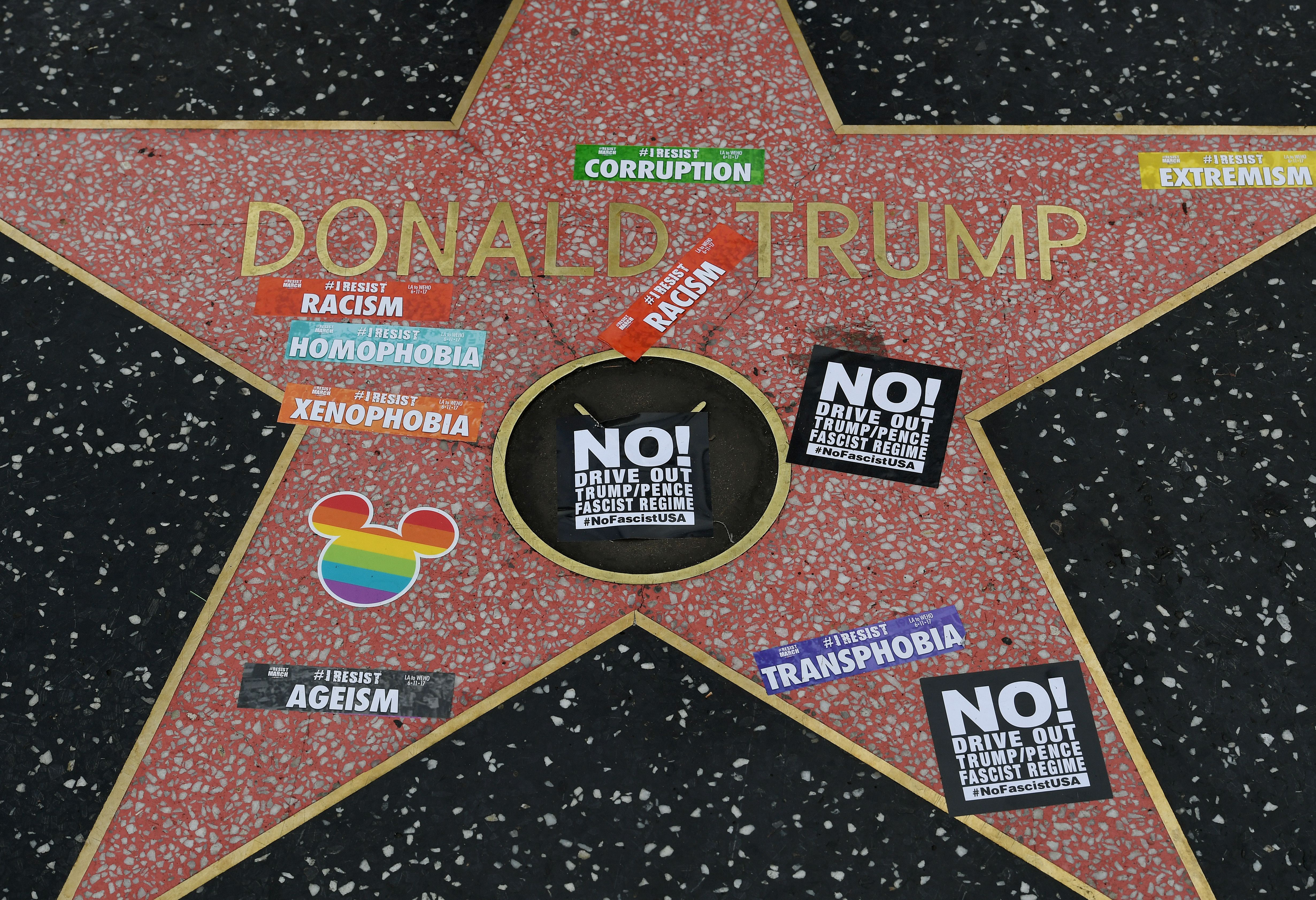 Gay pride stickers placed on the Hollywood Walk of Fame Star of President Donald Trump in Hollywood, Calif. on June 11, 2017.