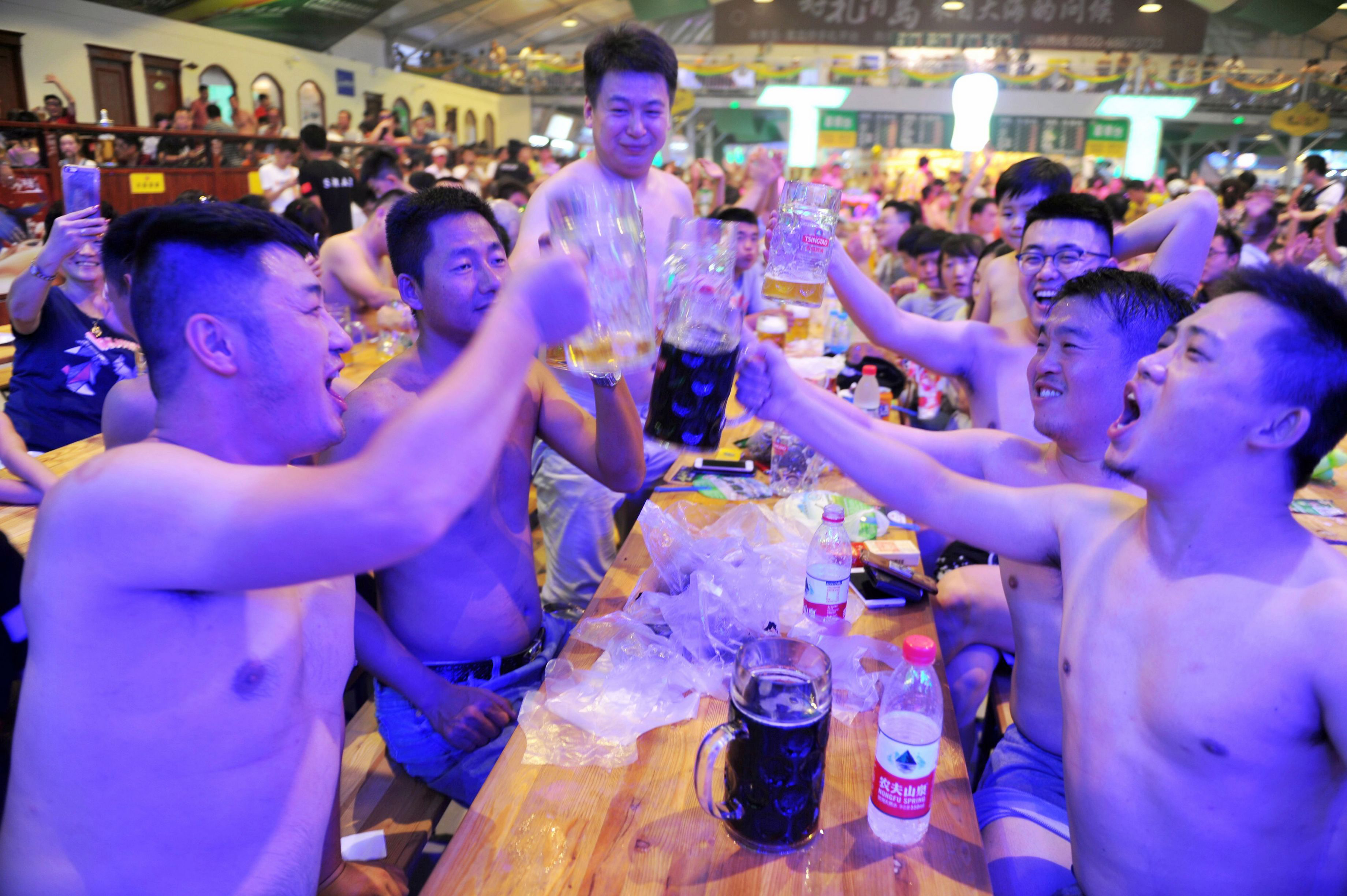 This photo taken on Aug. 7, 2017 shows people toasting at the annual Qingdao Beer Festival in China's eastern Shandong province.