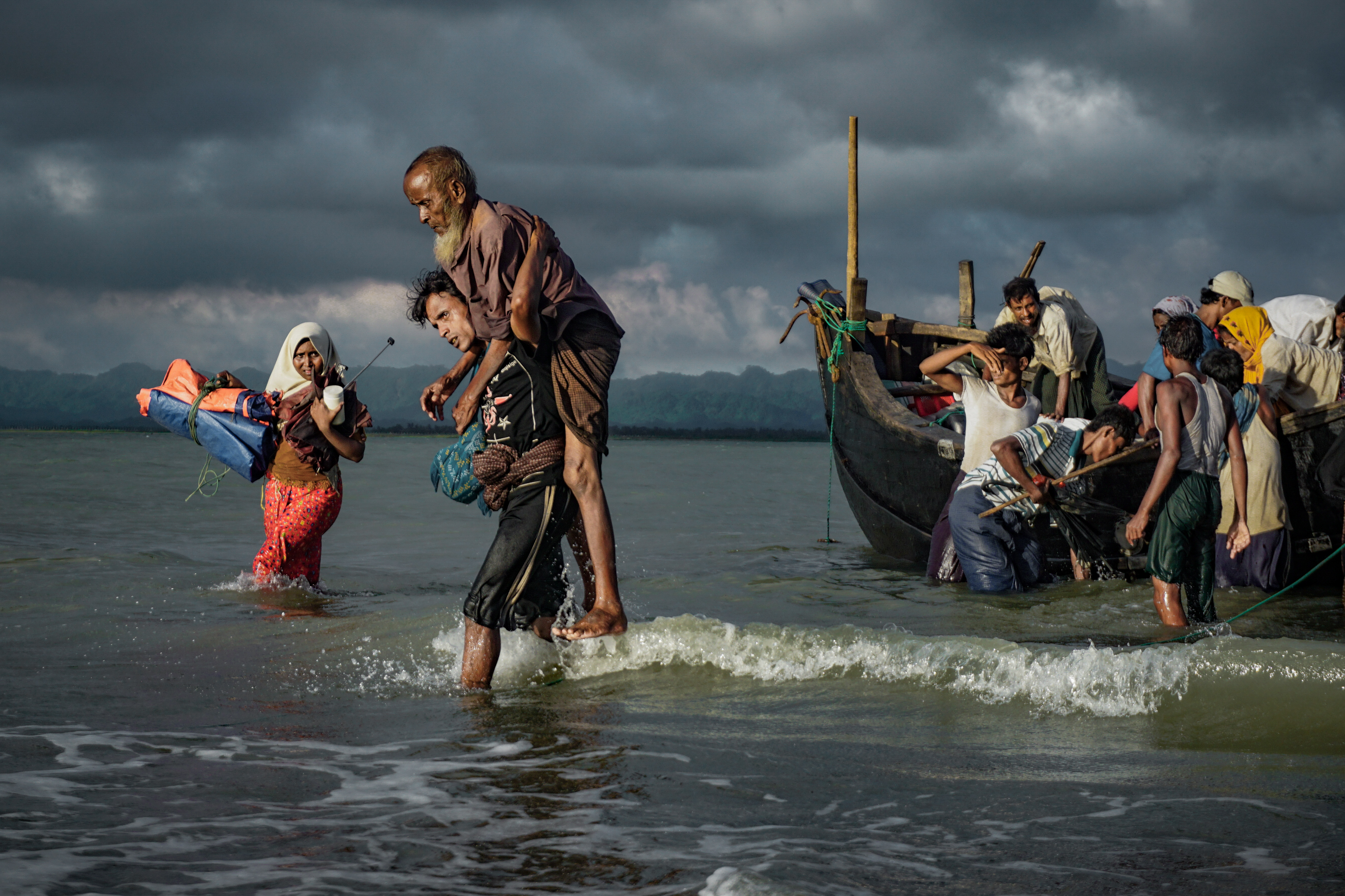 Rohingya Muslim refugees disembark from a boat on the Bangladeshi side of the Naf River in Teknaf on Sept. 13, 2017.