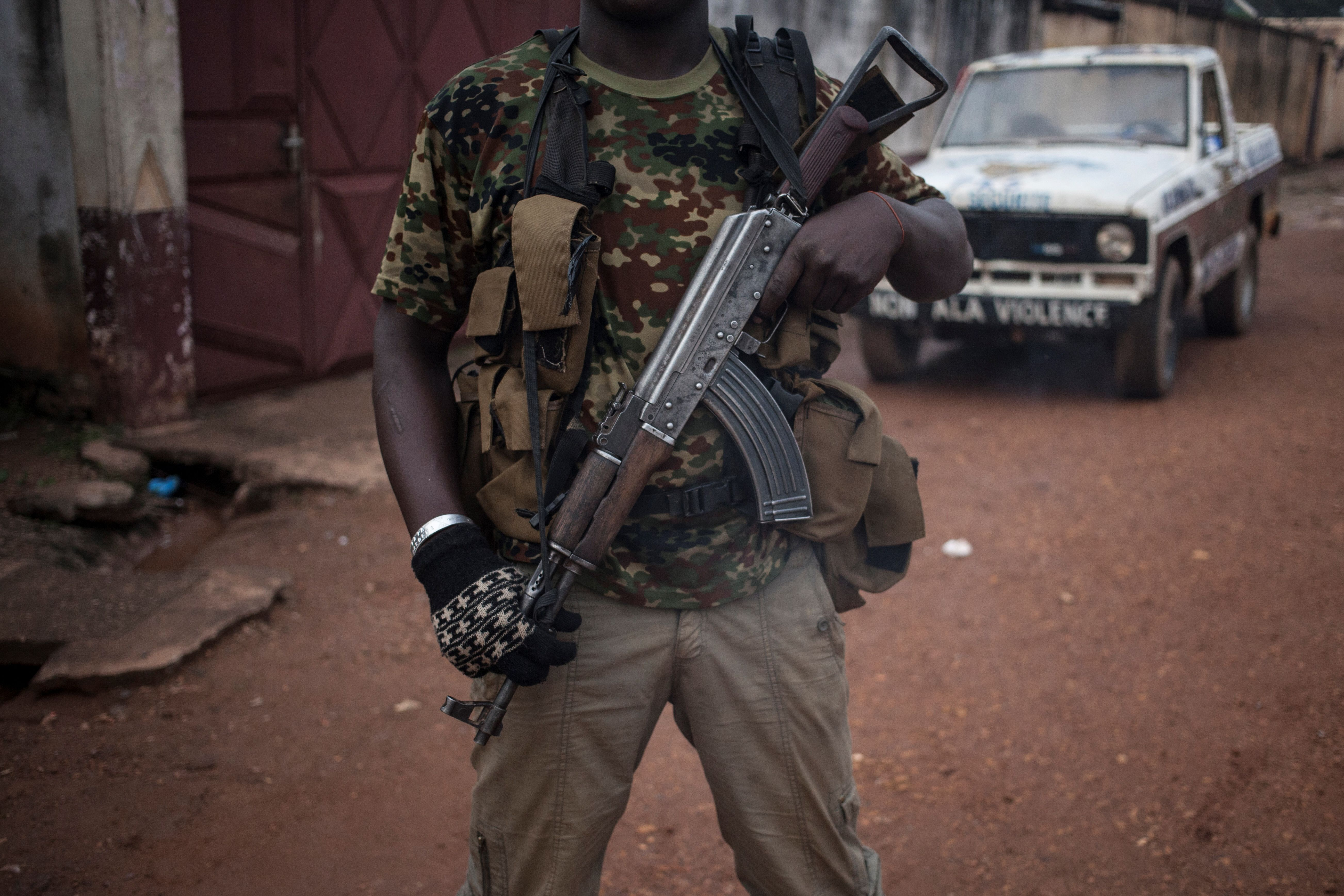 An armed militiaman stands guard in the PK5 neighborhood of Bangui, the capital of the Central African republic on Nov. 15, 2017.