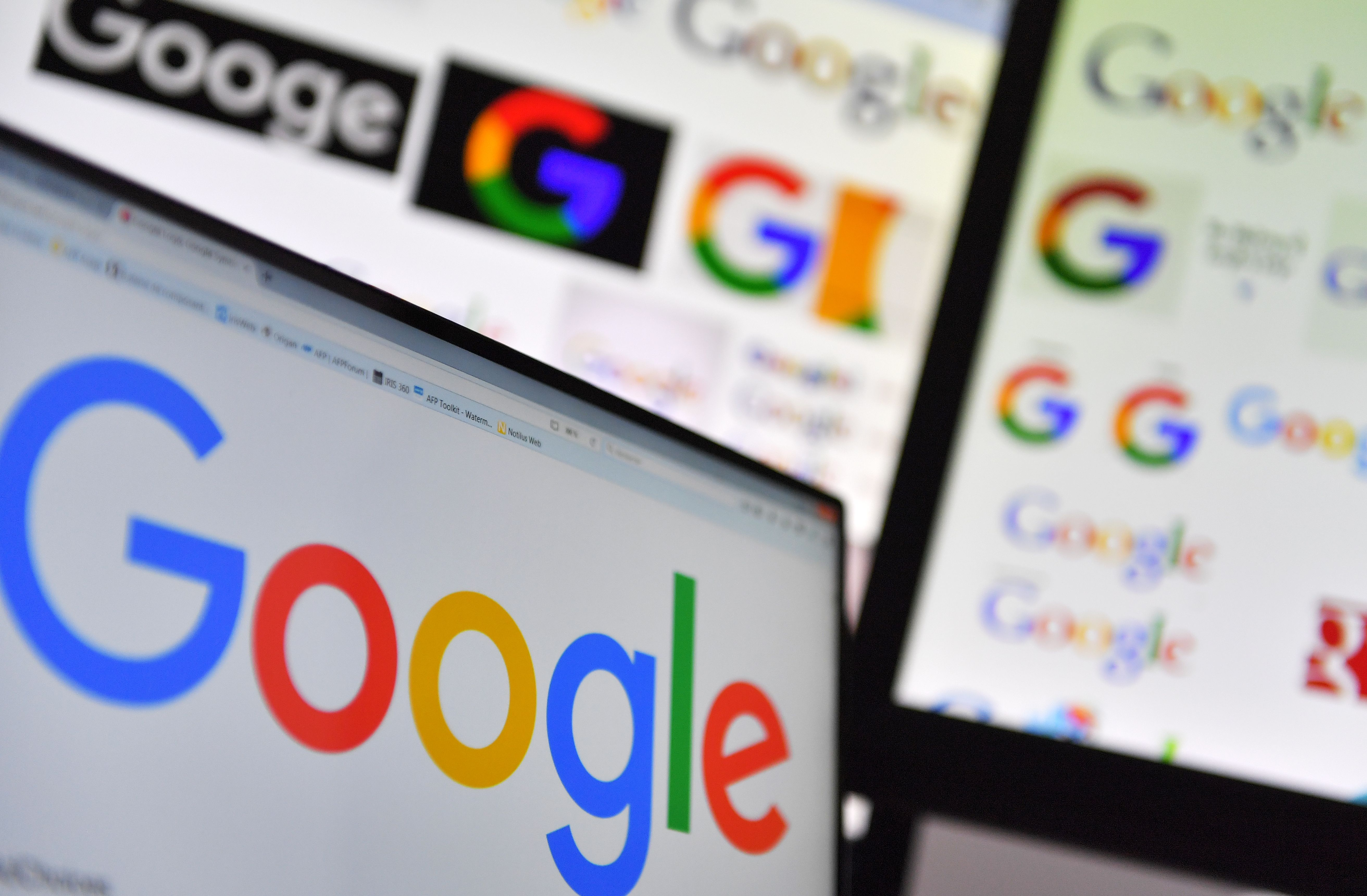 A picture taken on Nov. 20, 2017 shows logos of US multinational technology company Google displayed on computer screens.