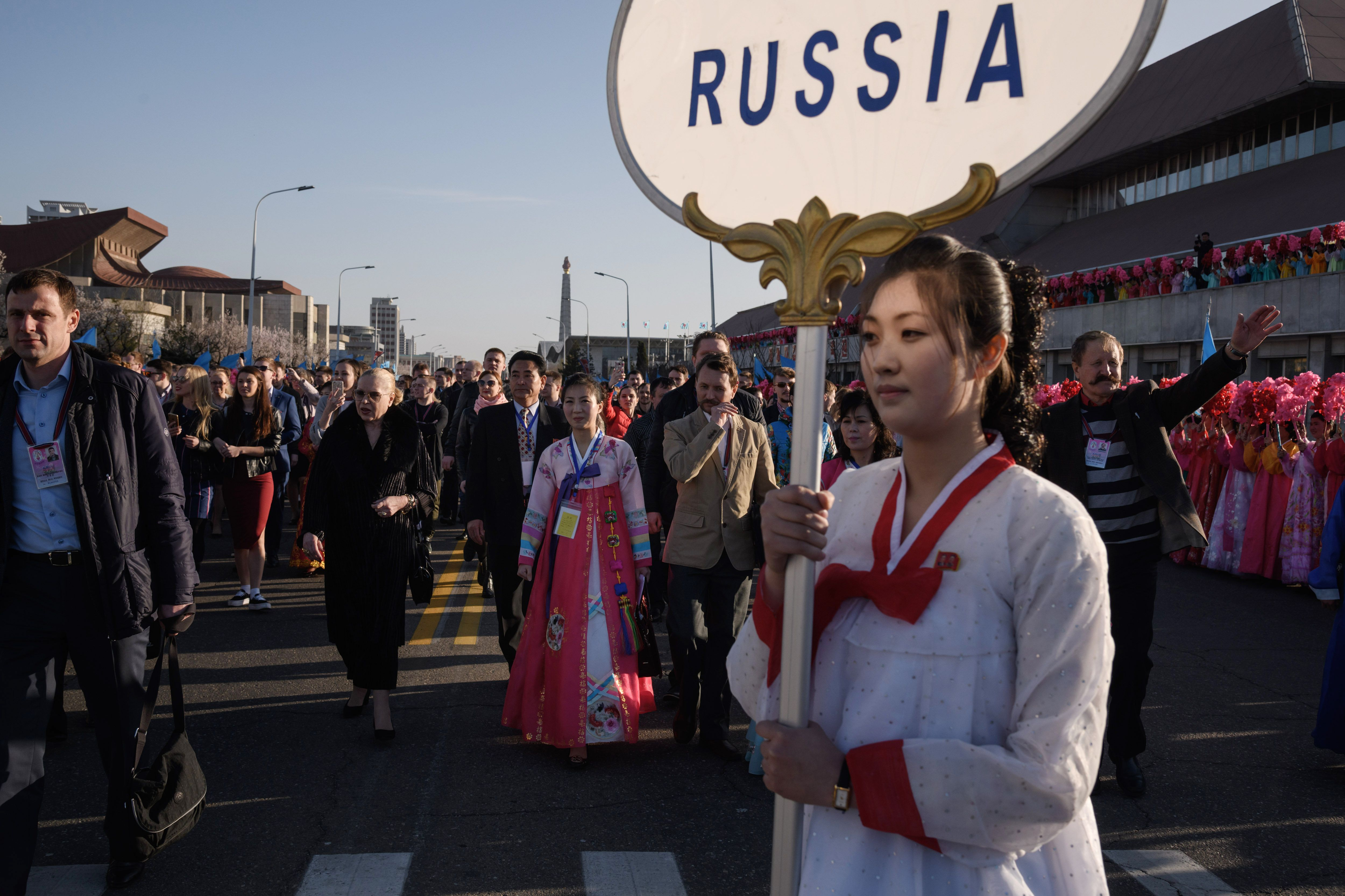 A performance troupe from Russia arrives in Pyongyang on April 12, 2018 during a cultural exchange and arts festival.