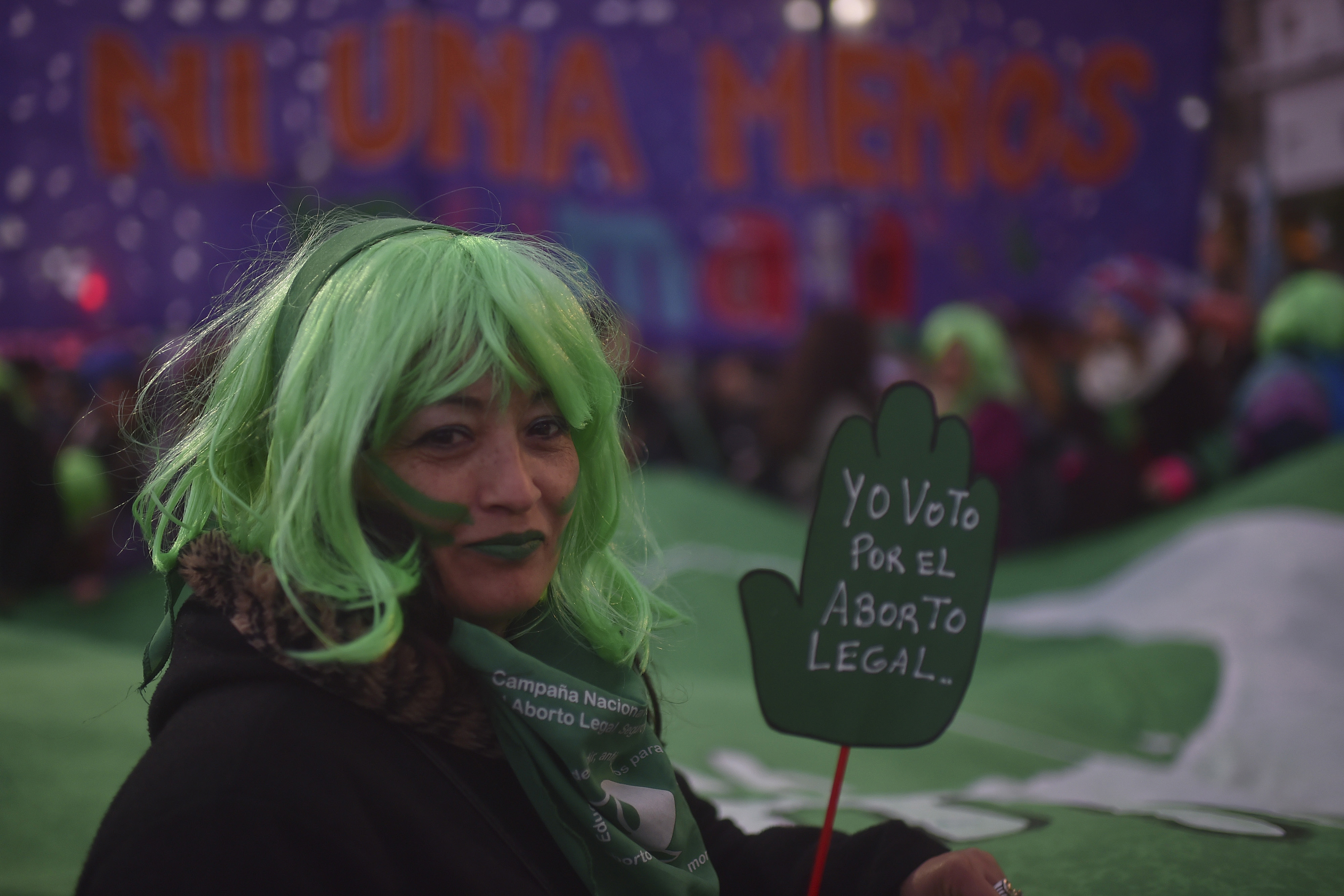 A woman shows a sign that reads 'I vote in favour of legal abortion' during a protest as part of the 'Not One Less' (Ni Una Menos) movement demanding legal abortion on June 04, 2018 in Buenos Aires, Argentina.