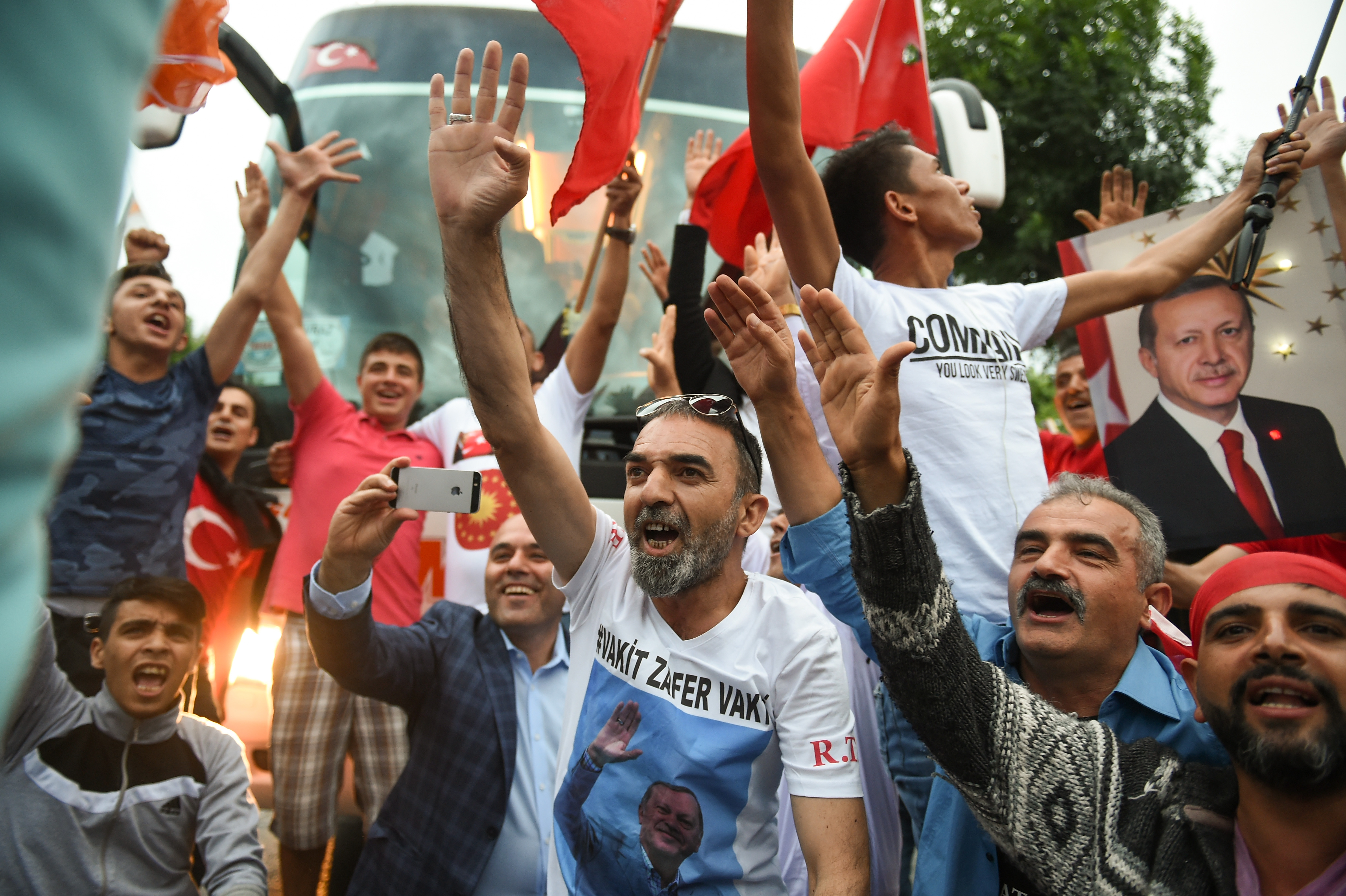 President Recep Tayyip Erdogan's supporters celebrate outside the AK party headquarters on June 24, 2018 in Istanbul, Turkey
