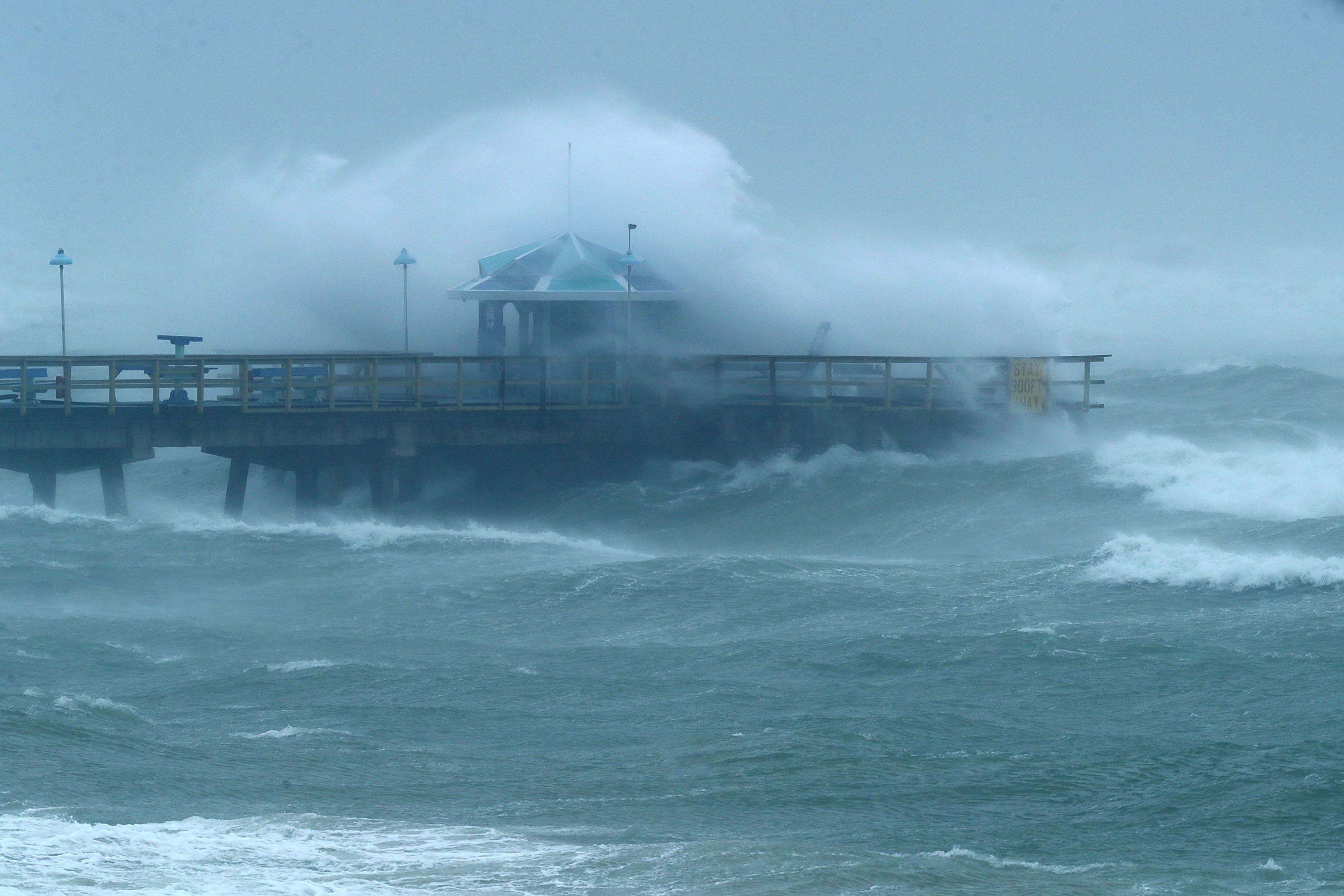 Large waves produced by Hurricane Irma crash into the end of Anglins Fishing Pier in Fort Lauderdale, Fla. on Sept. 10, 2017