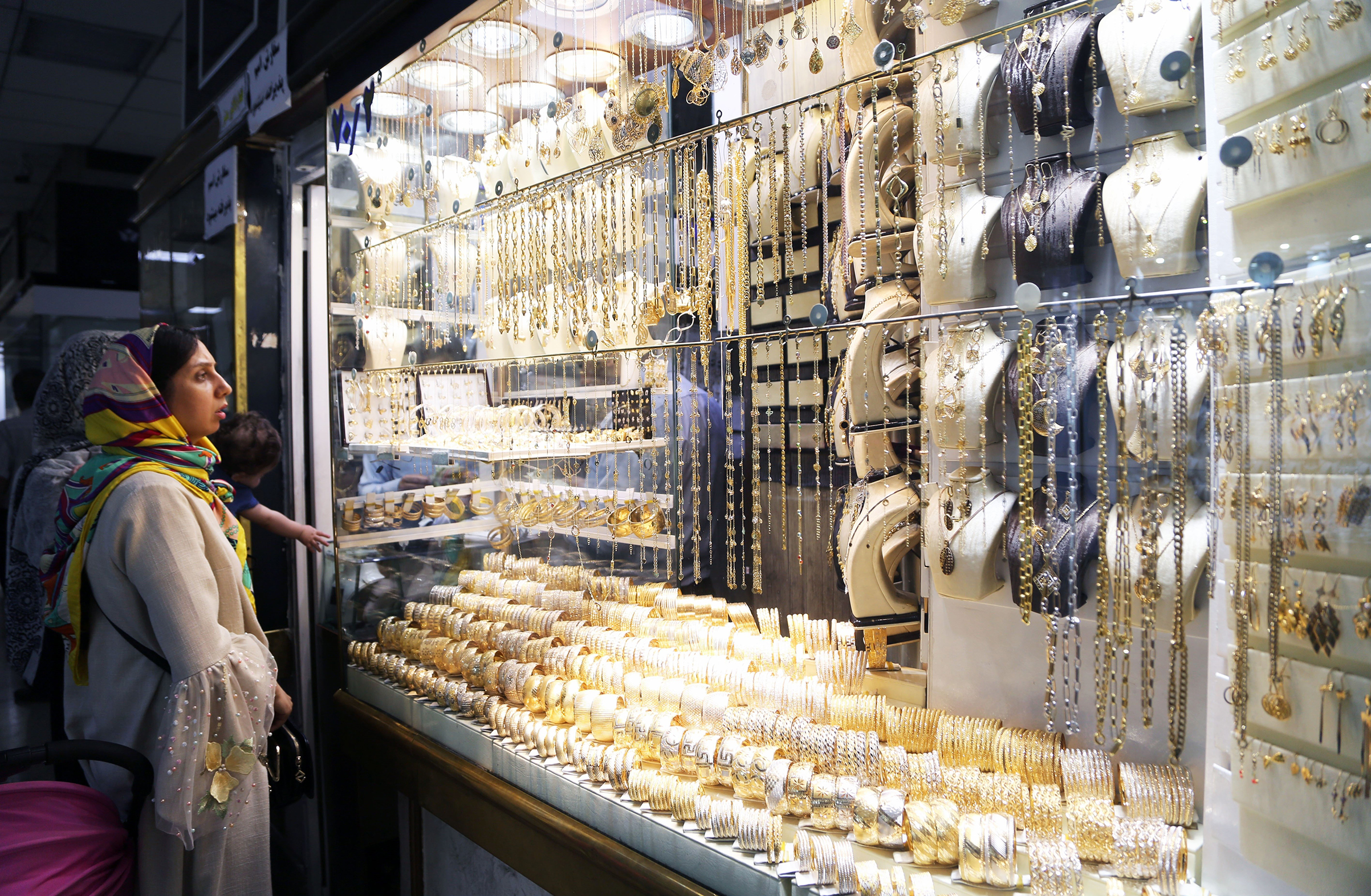 A woman looks at golden jewelleries at Grand Bazaar as daily life continues despite of the U.S. sanctions against Iran on August 08, 2018 in Tehran, Iran.