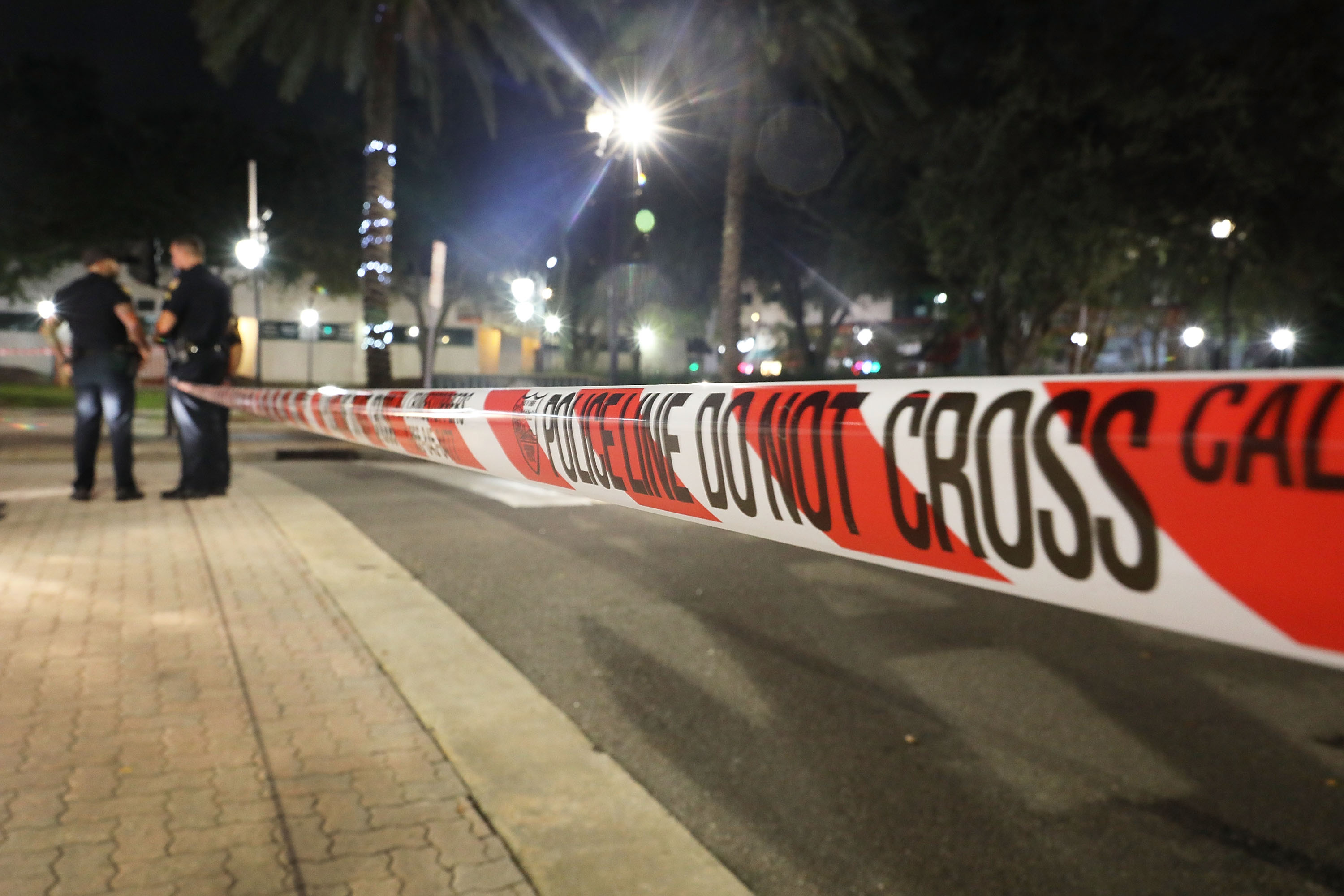 Police tape is seen as law enforcement officials investigate a shooting at the GLHF Game Bar located in the Jacksonville Landing on August 27, 2018.