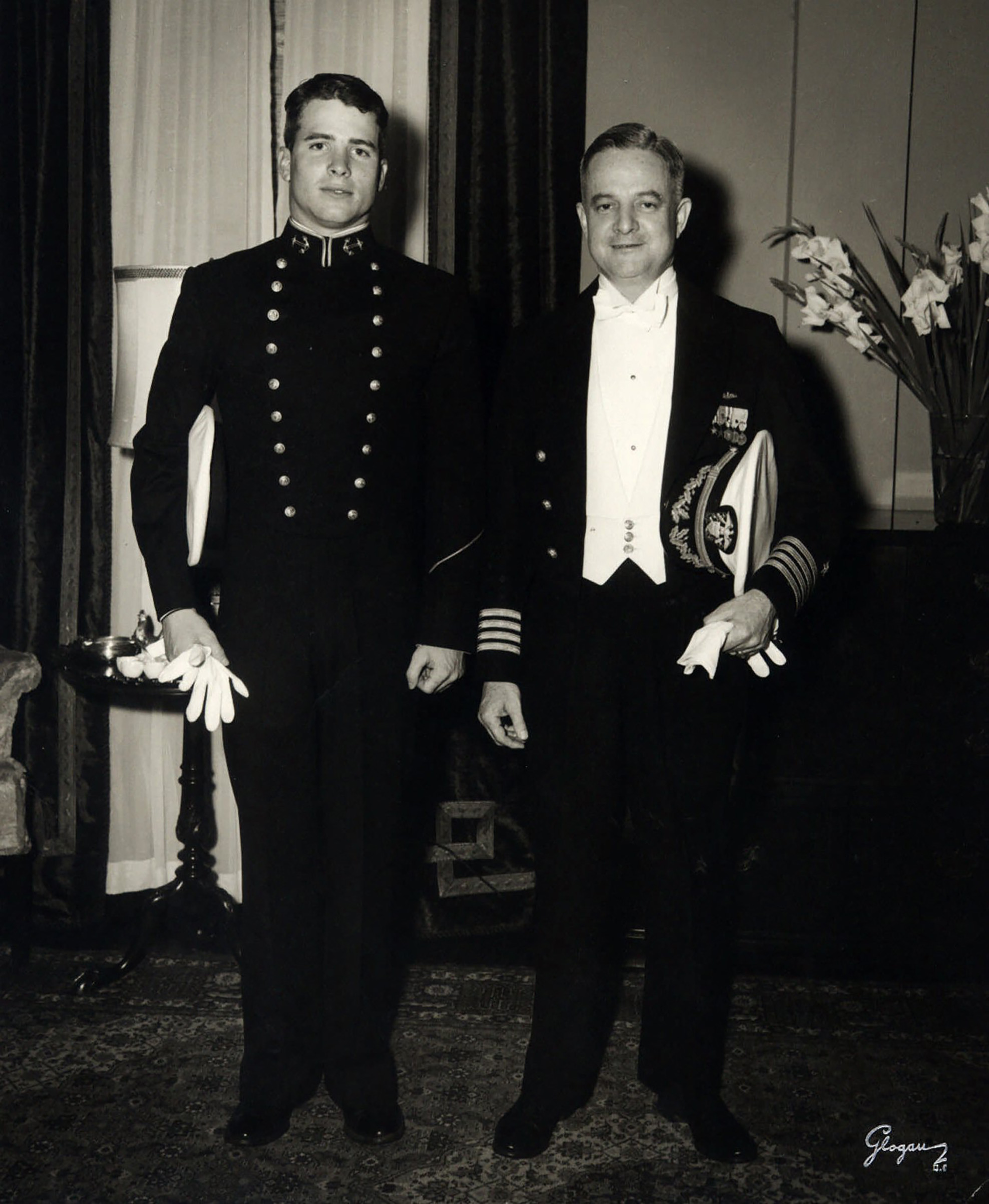 John McCain, left, stands in military dress uniform next to his father, John S. McCain, Jr., in this undated photo.