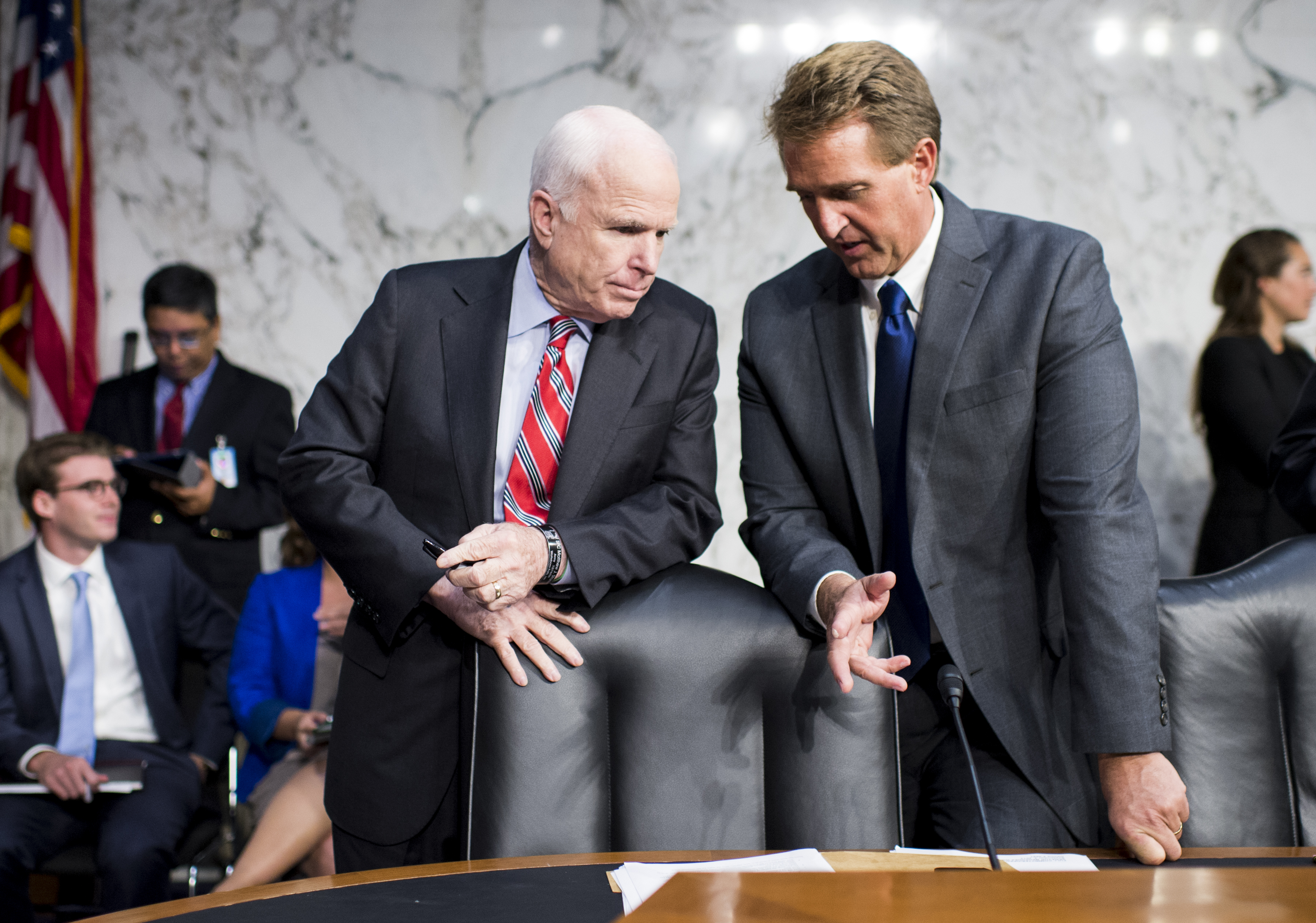 Sen. John McCain, R-Ariz., left, and Sen. Jeff Flake, R-Ariz., talk before the start of the Senate Foreign Relations hearing to debate the authorization for use of military force in Syria on Tuesday, Sept. 3, 2013.