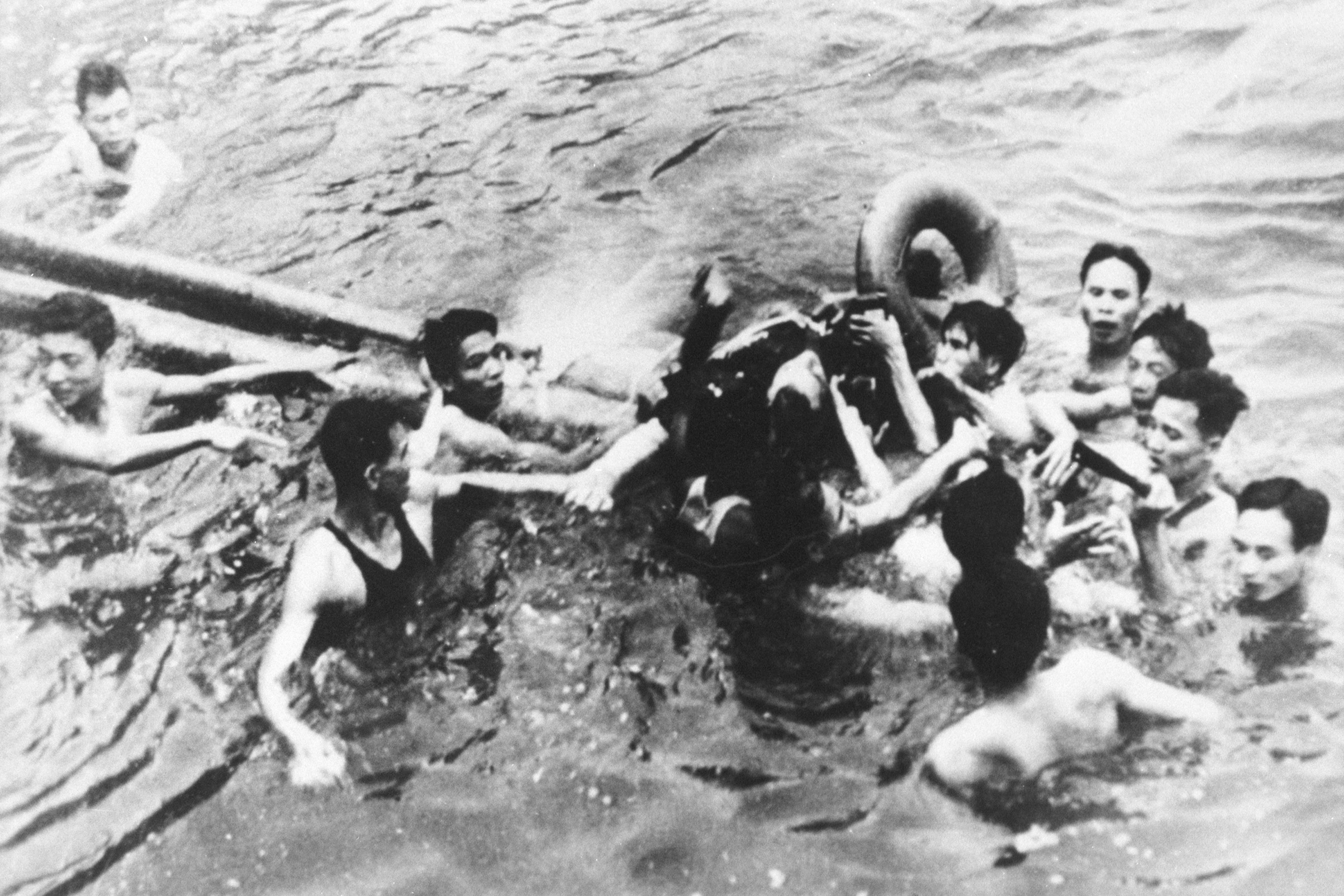 Senator John McCain is pulled out of a Hanoi lake by North Vietnamese army soldiers and civilians on Oct. 26, 1967.
