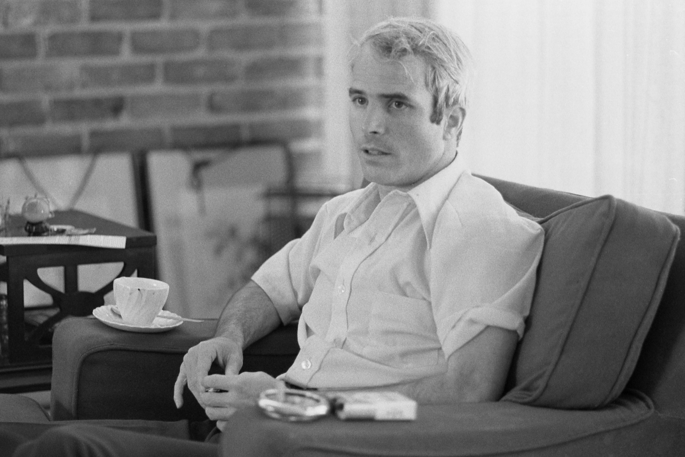 American soldier and Vietnam prisoner of war John McCain sits on a sofa during an interview, about a month after he had been released and returned from Vietnam, on April 24, 1973.