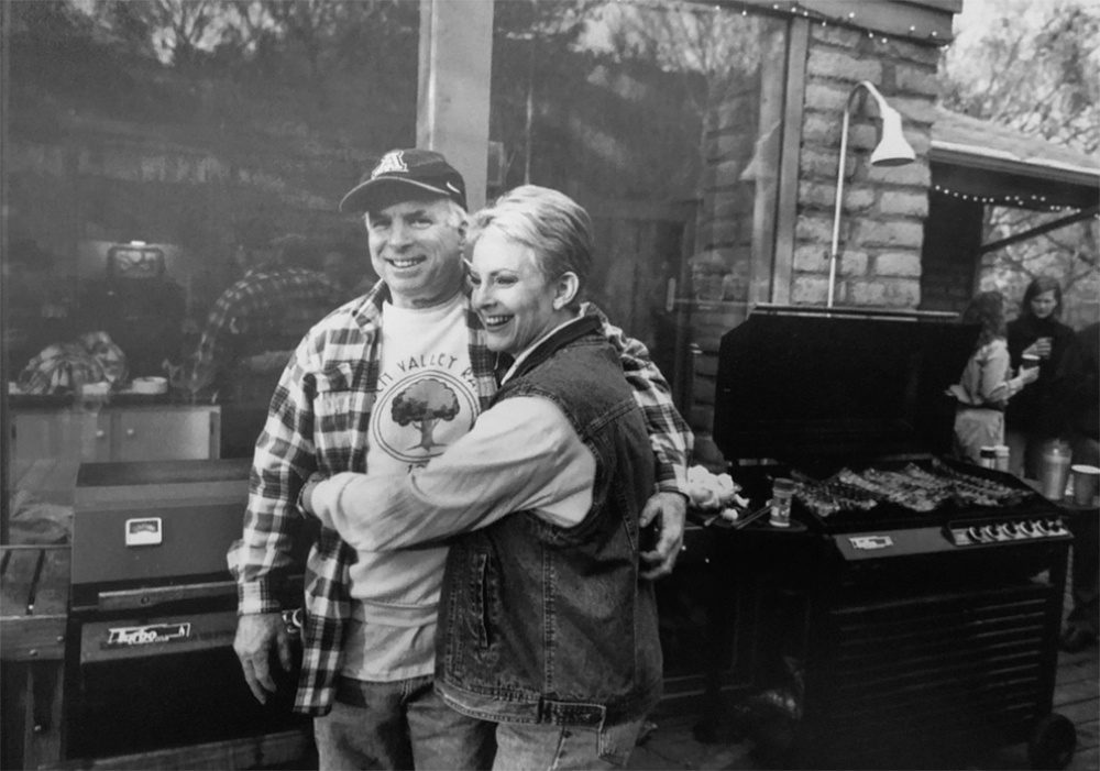 A previously unpublished image of Sen. John McCain with his wife Cindy enjoying a barbecue at his ranch outside Sedona, Arizona.  This is back in 2000 when the McCains welcomed me into their world. After bowing out of the race for the Republican nomination for president. Senator McCain invited then Gov. George Bush and his wife Laura to his Ranch. Putting aside the brutal... campaign that the Bush team ran against him.