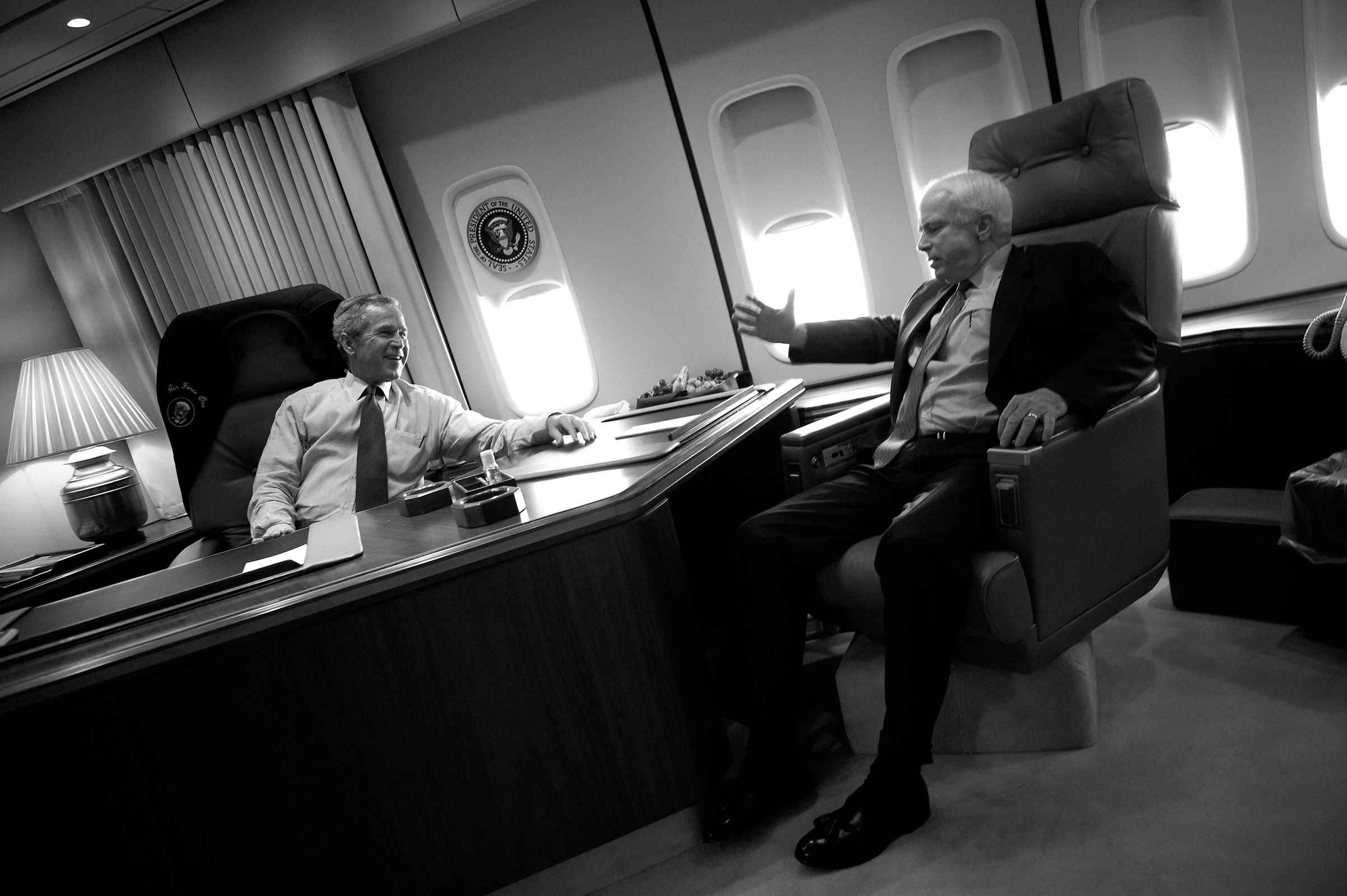 President George W. Bush with Sen. John McCain on board Air Force One on August 11, 2004.