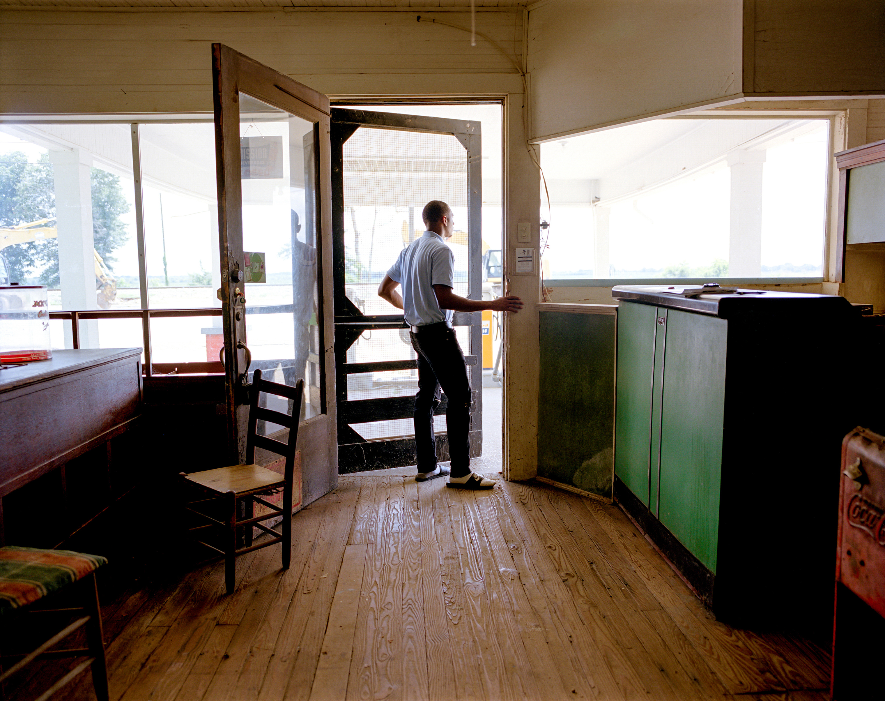 Rodkevian Thomas, an intern with the Emmett Till Interpretive Center, visits the restored service station adjacent to the dilapidated Bryant's Grocery in Money, Miss. On August 24, 1955, 14-year-old Emmett Till was visiting Bryant's Grocery when he was accused of violating the racial customs of the time by whistling at a white woman. He was then kidnapped, beaten and, on Aug. 28, lynched.