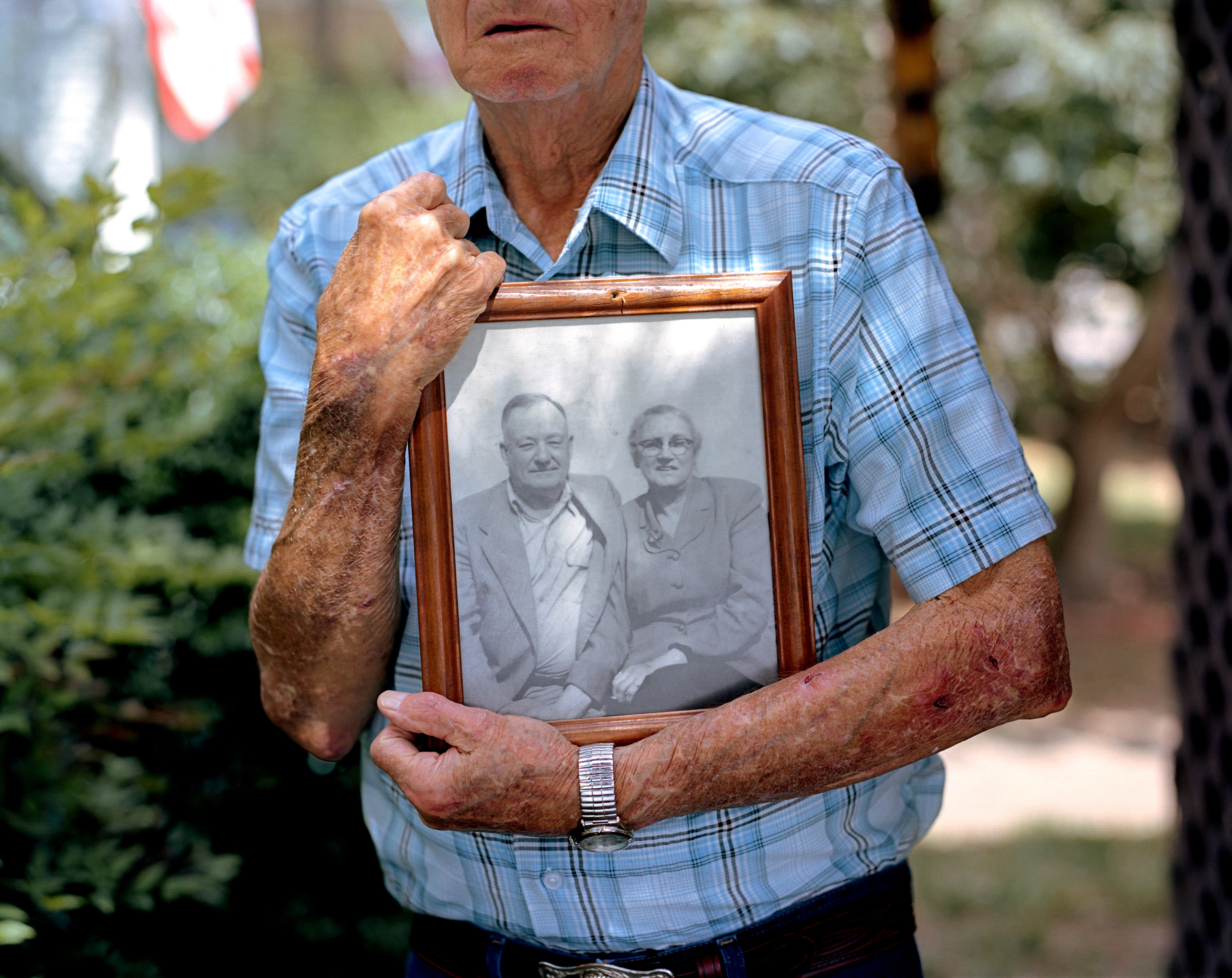 Gene Bowen holds a photograph of his parents at his home in LaGrange, Ga. Bowen was six years old when he awoke on a Sunday morning in 1940 to find his parents outside the home attending to a young African-American man, Austin Callaway, found bleeding to death on their property. The family wrapped the unconscious man in a bed sheet and rushed him to the local hospital, where he succumbed to his wounds. Callaway had been arrested the evening before. An armed group of hooded men snatched him from police custody without resistance, drove him to the edge of town, shot him multiple times and had left him to die.
