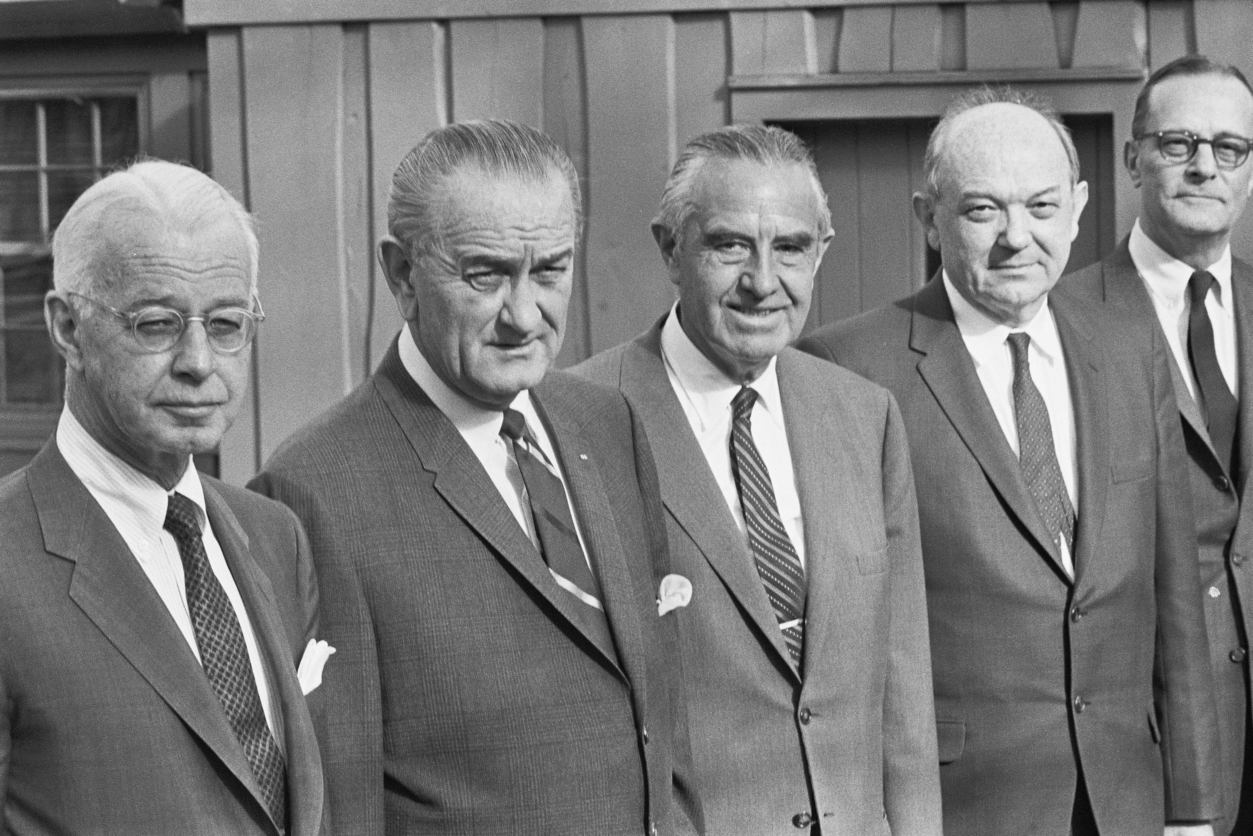 President Johnson is joined by several of his top advisors at Camp David to discuss the Vietnam War. It is believed by some that the meeting was held so as to excuse the president from attending Martin Luther King, Jr.'s funeral.