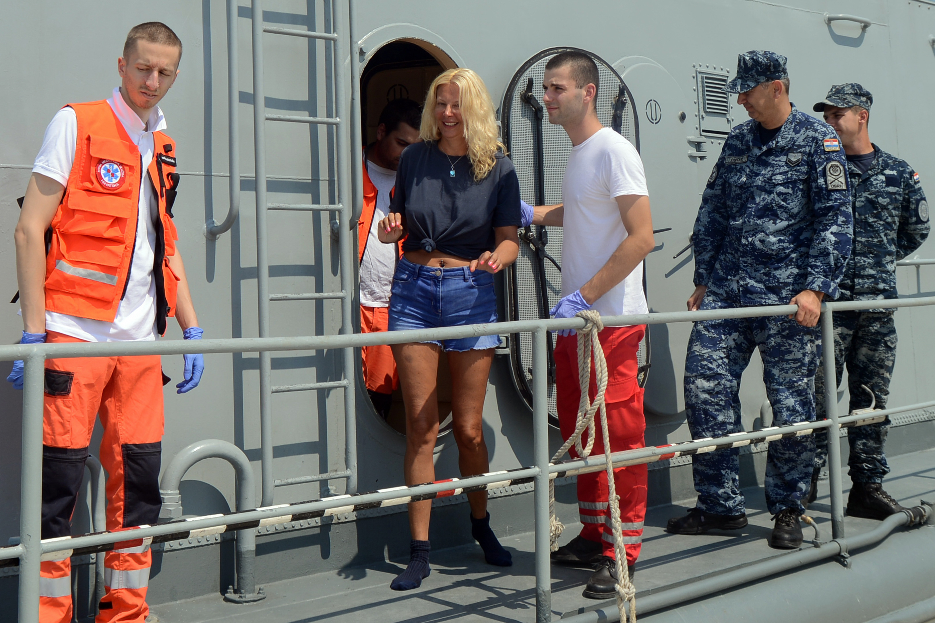 British tourist Kay Longstaff (C) exits Croatias coast guard ship in Pula, on August 19, 2018, which saved her after falling off a cruise ship near Croatian coast.