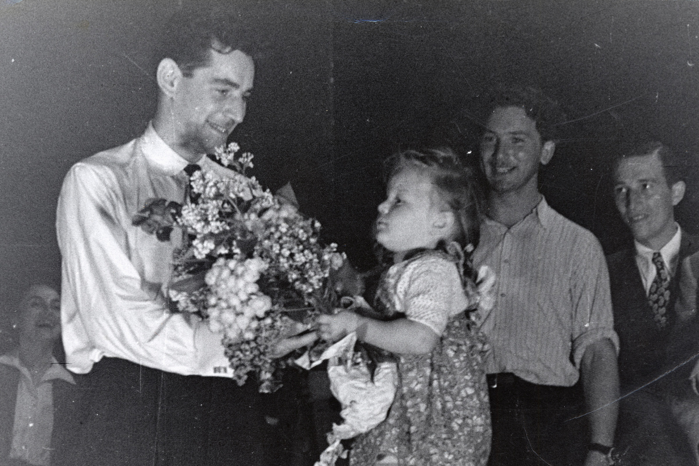 Leonard Bernstein receives flowers from an admirer after conducting an orchestra of concentration camp survivors for a concert sponsored by the American Jewish Joint Distribution Committee on May 10, 1948, outside Munich.