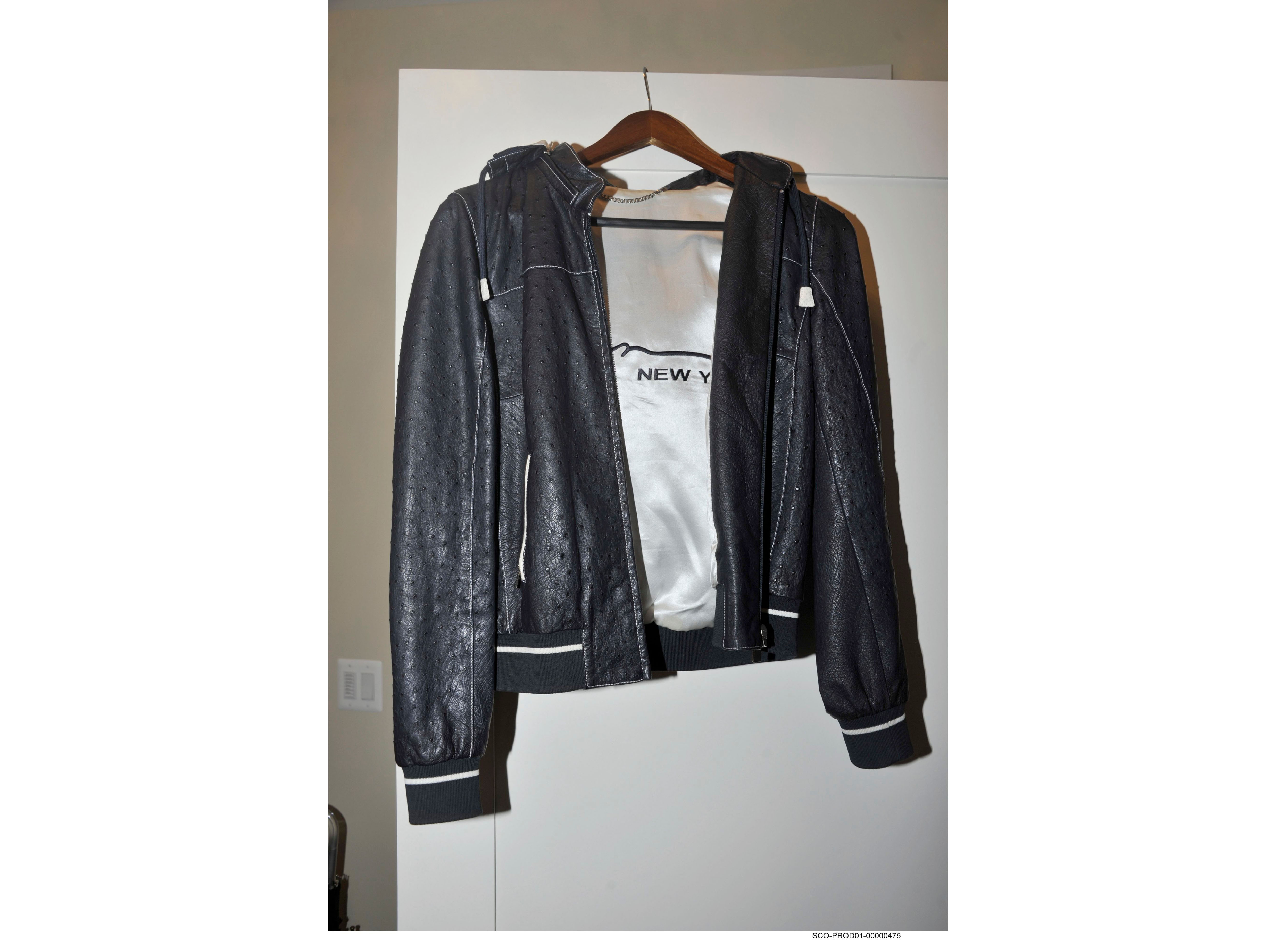 This photo provided by the Department of Justice was introduced into evidence by the government, during the second day of the fraud trial of former Trump campaign chairman Paul Manafort in federal court in Alexandria, Va., shows Manafort's $15,000 jacket made of ostrich on Aug. 1, 2018.