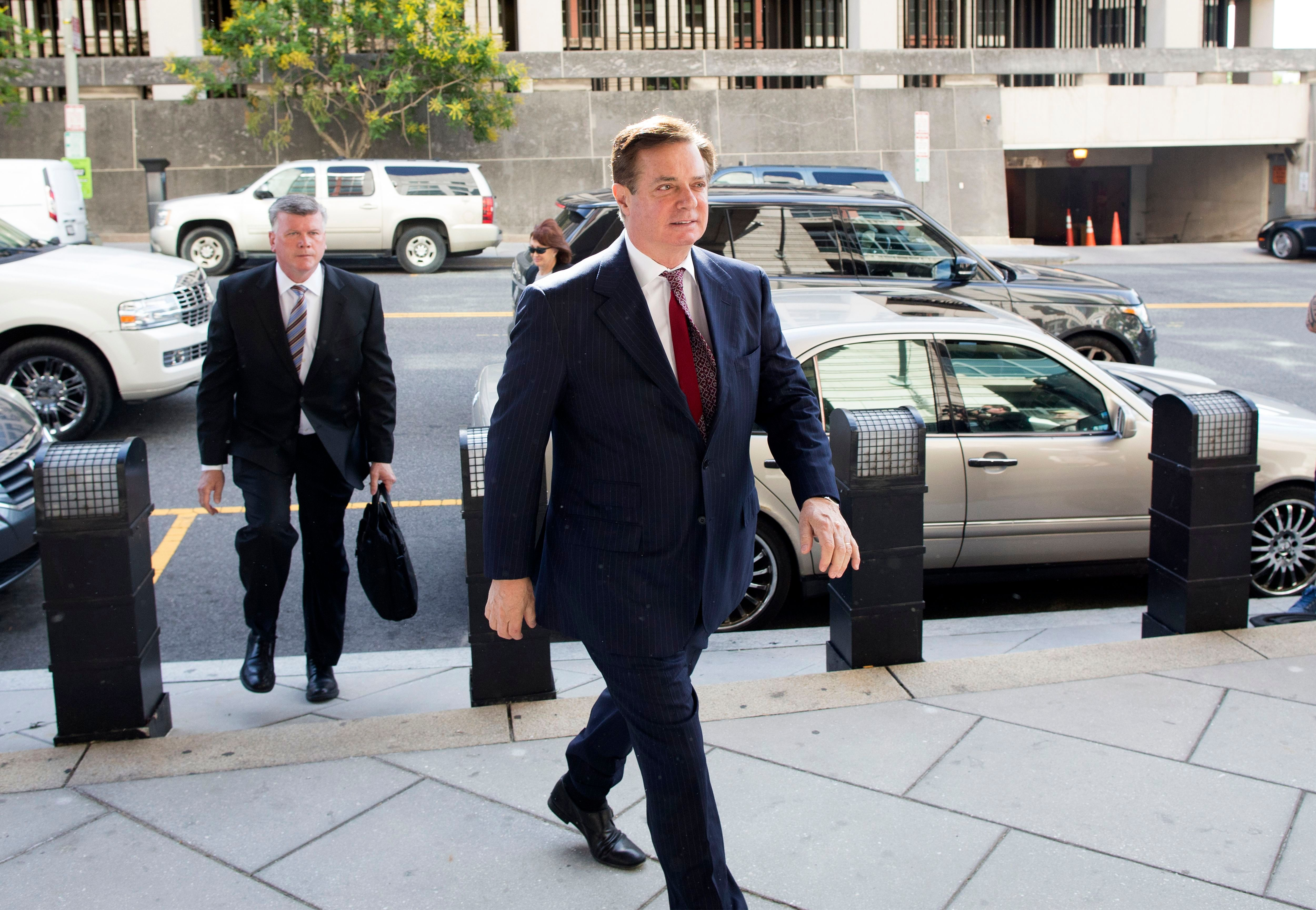 Former Trump campaign chairman Paul Manafort (C) and his attorney Kevin Downing (L) arrive at the Federal Courthouse in Washington, DC, USA, 15 June 2018.