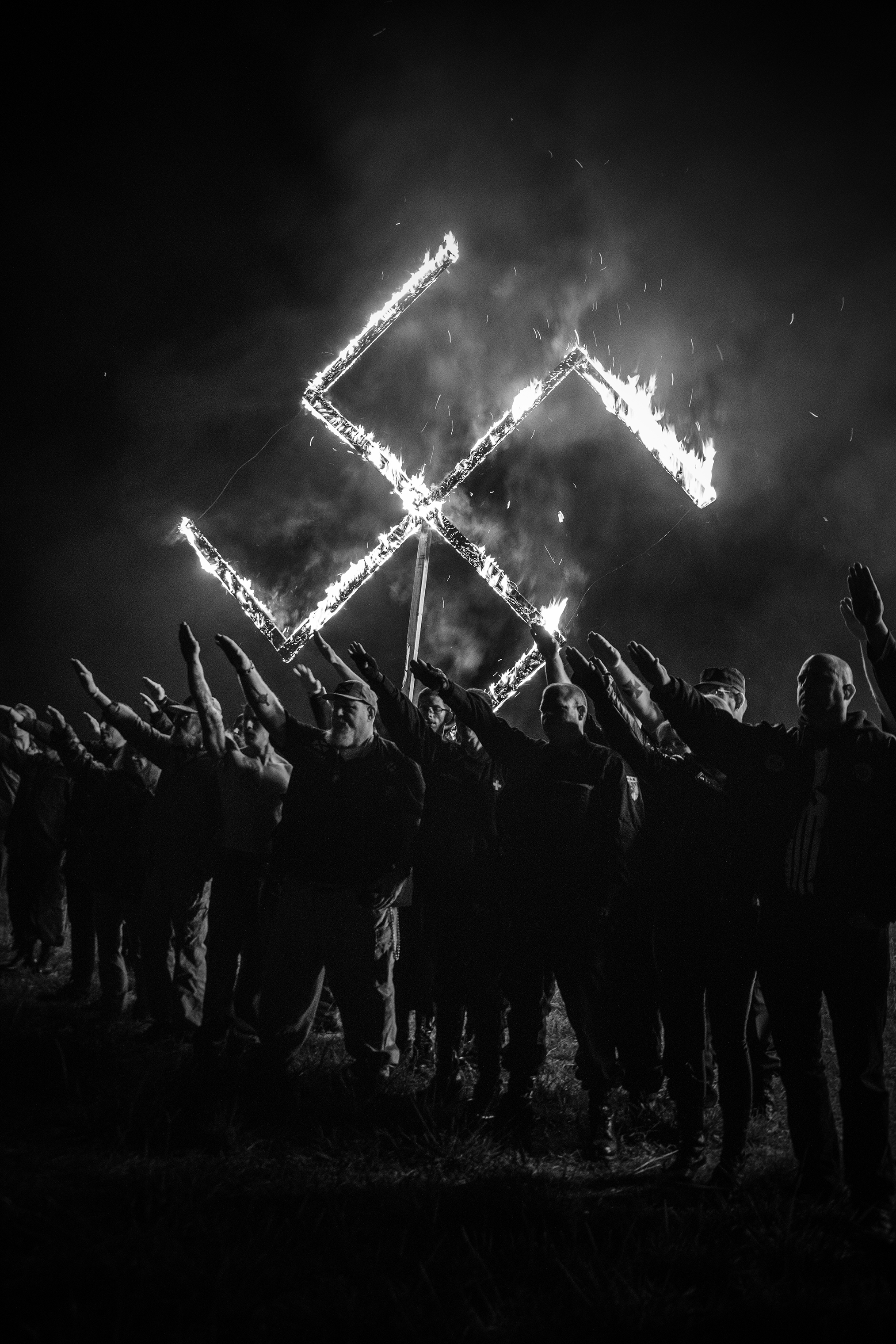 The National Socialist Movement holds a lighting ceremony following a rally that was held in Newnan, Ga., on April 21, 2018.