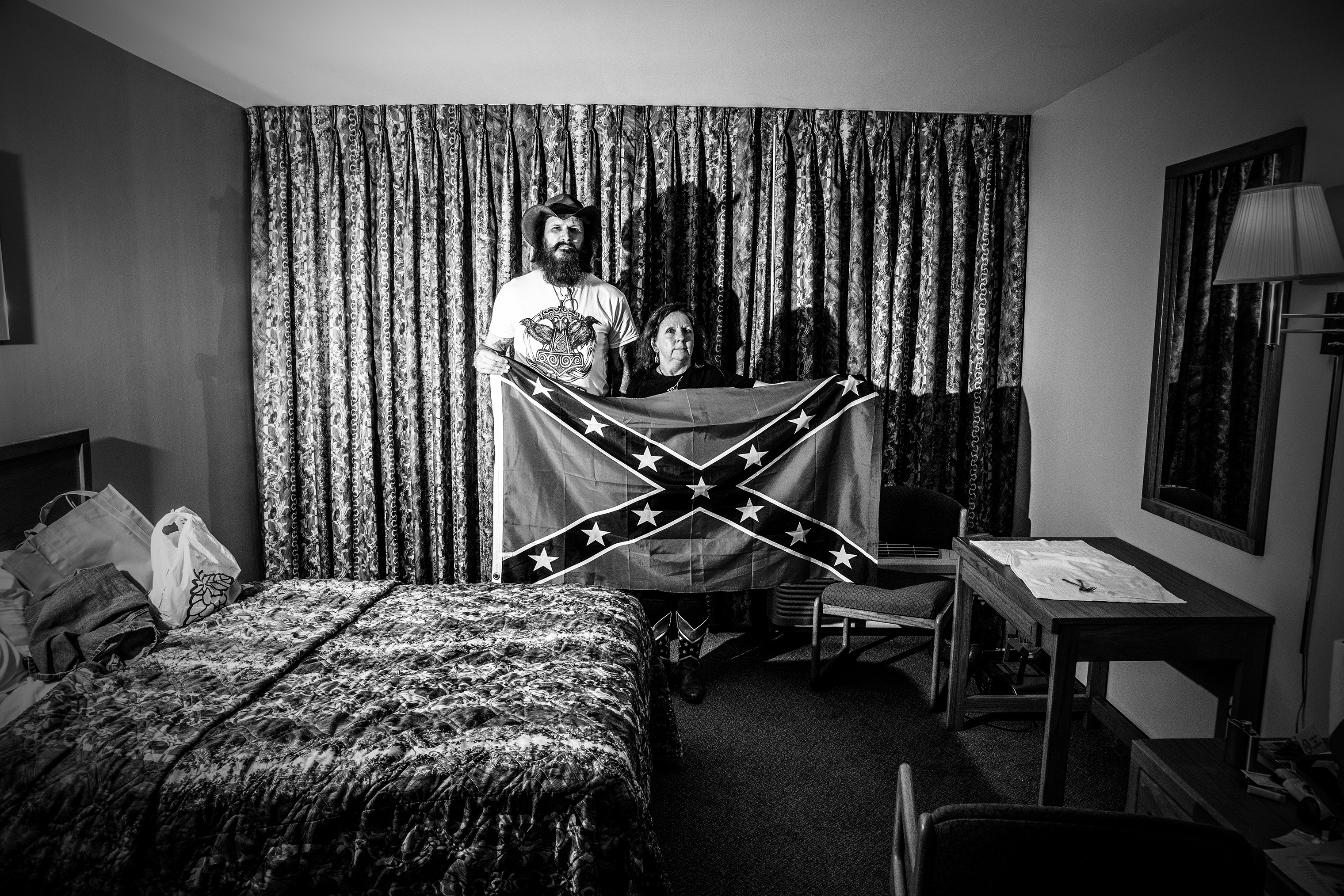 Mr. and Mrs. McDonald pose with a Confederate flag in their hotel room while attending the American Freedom Party and Council of Conservative Citizens conference in Nashville, a conference attended by white nationalist supporters and white supremacists, on June 16, 2018.