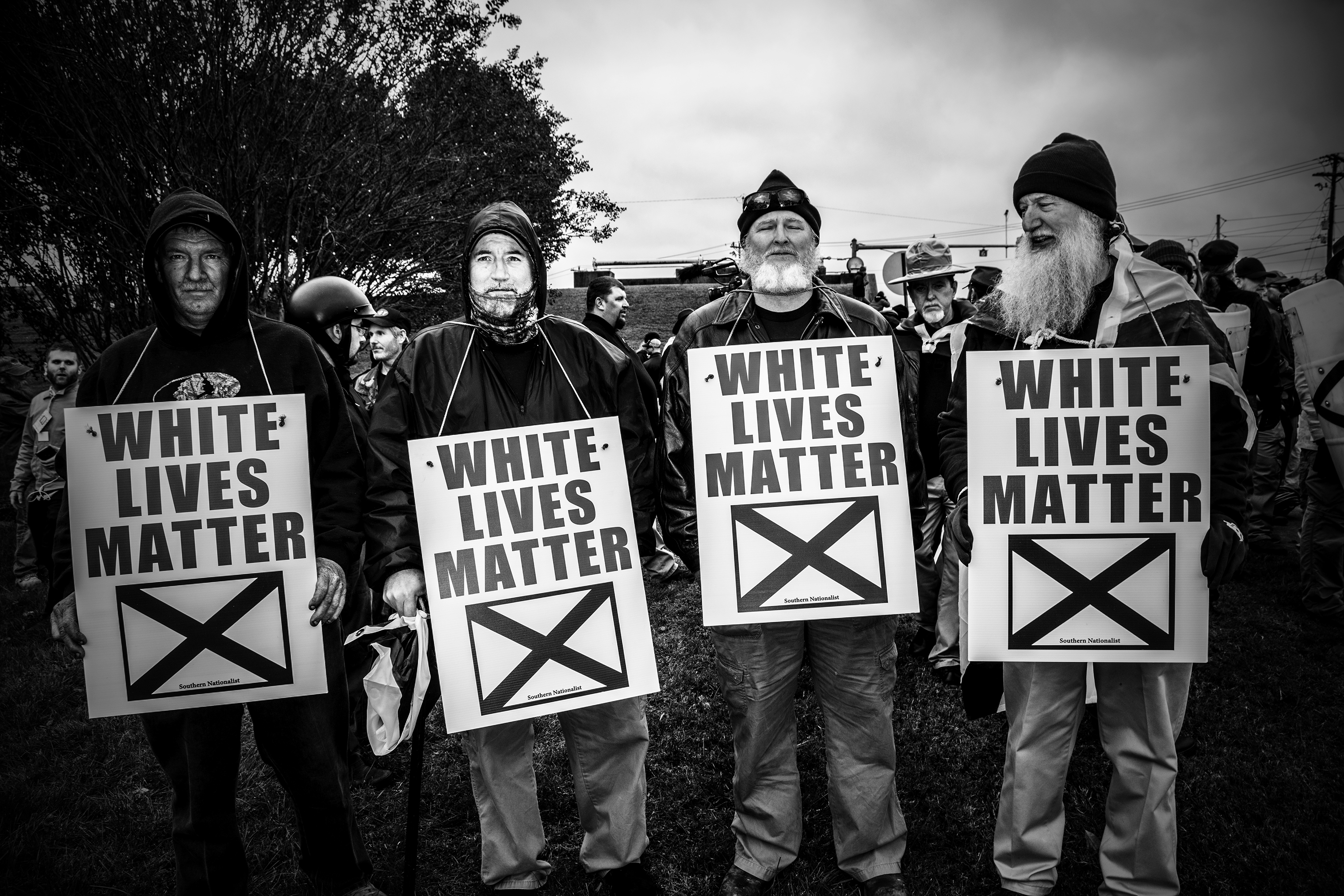 Members of the white supremacist organization League of the South, wear 'White Lives Matter' signs during a rally in Shelbyville, Tenn., on Oct. 28, 2017.
