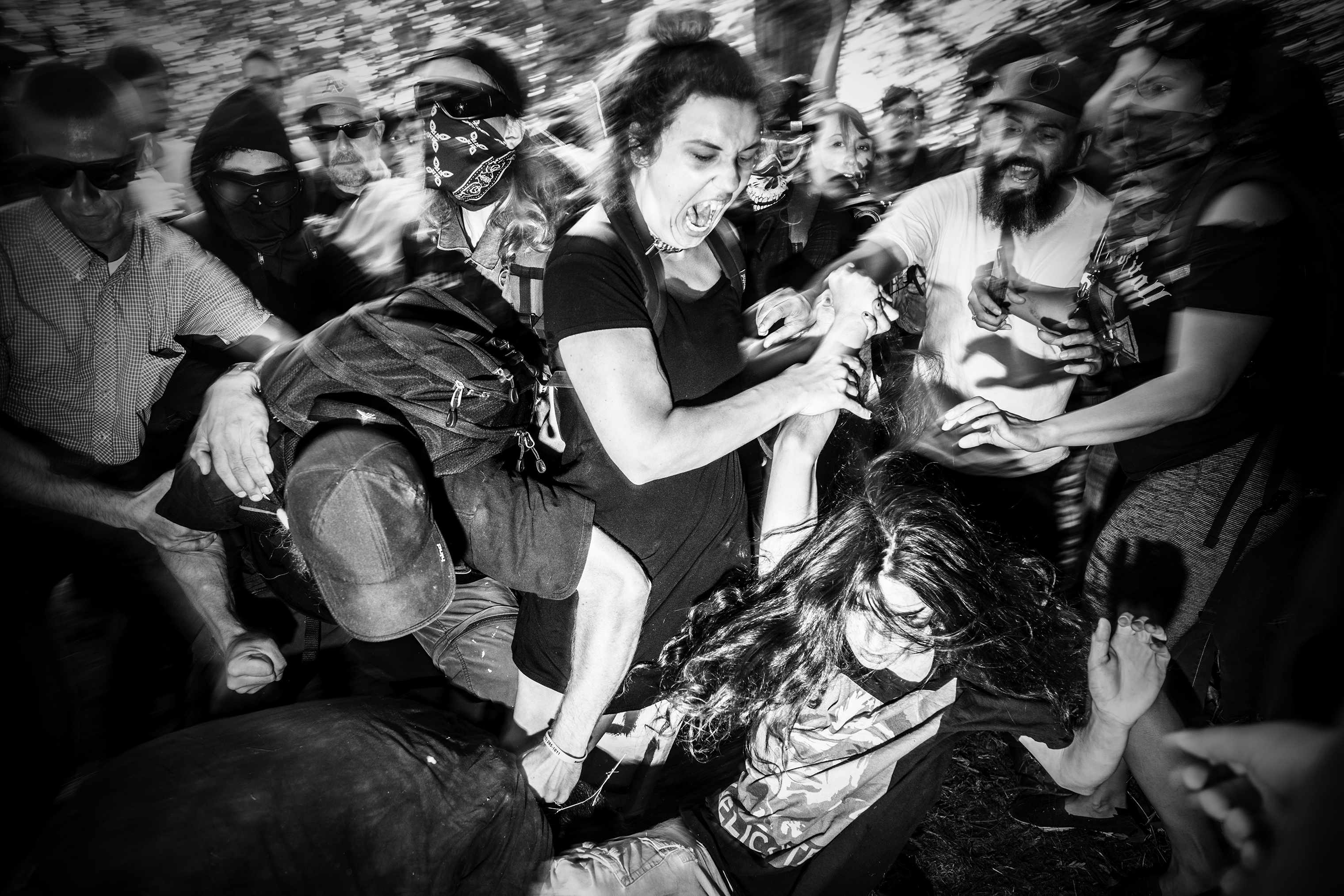 A man wearing a Trump t-shirt is attacked by members of Antifa during a cancelled 'No to Marxism' rally in Berkeley, Calif., on Aug. 27, 2017.