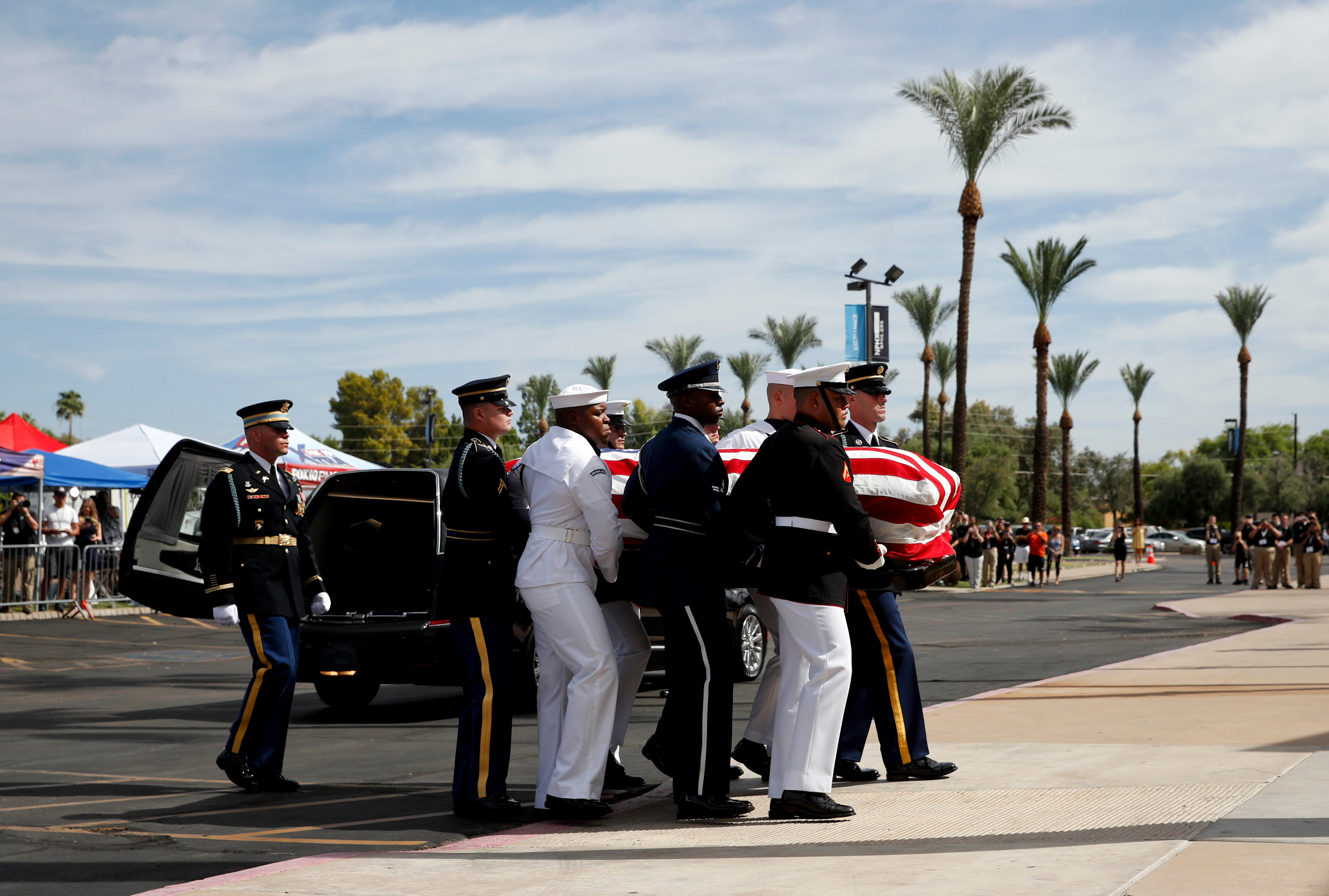 The honor guard carries the casket into the North Phoenix Baptist Church for a memorial service for Sen. John McCain, in Phoenix, Ariz., on Aug. 30, 2018.