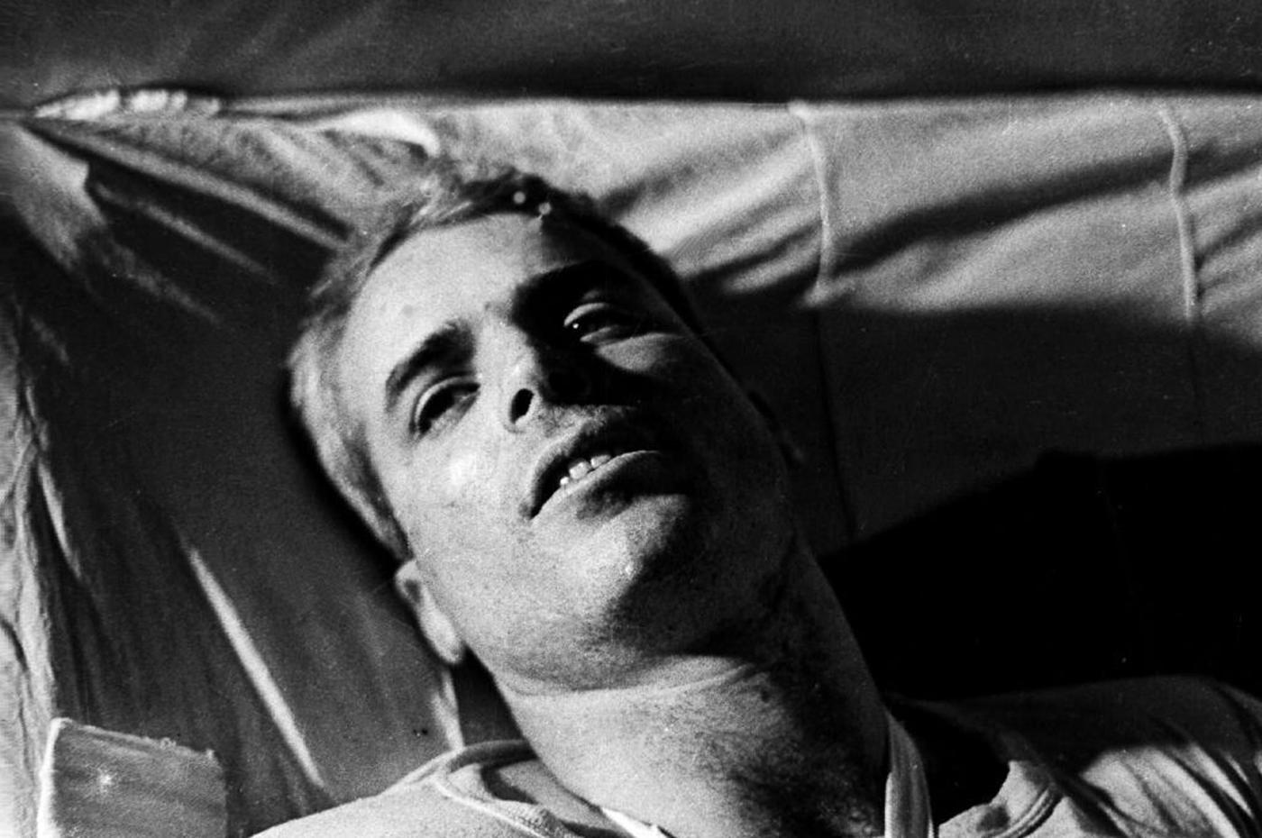 U.S. Navy Air-force Major John McCain lies on a bed in a Hanoi hospital as he was being given medical care for his injuries in Hanoi, Vietnam in 1967.