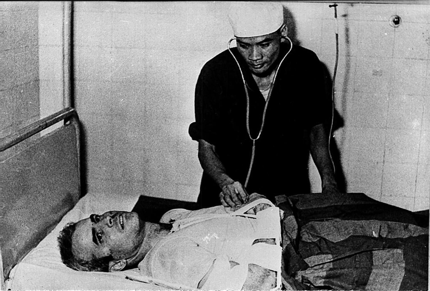 A photo taken in 1967 shows U.S. Navy Airforce Major John McCain being examined by a Vietnamese doctor in Hanoi, Vietnam.