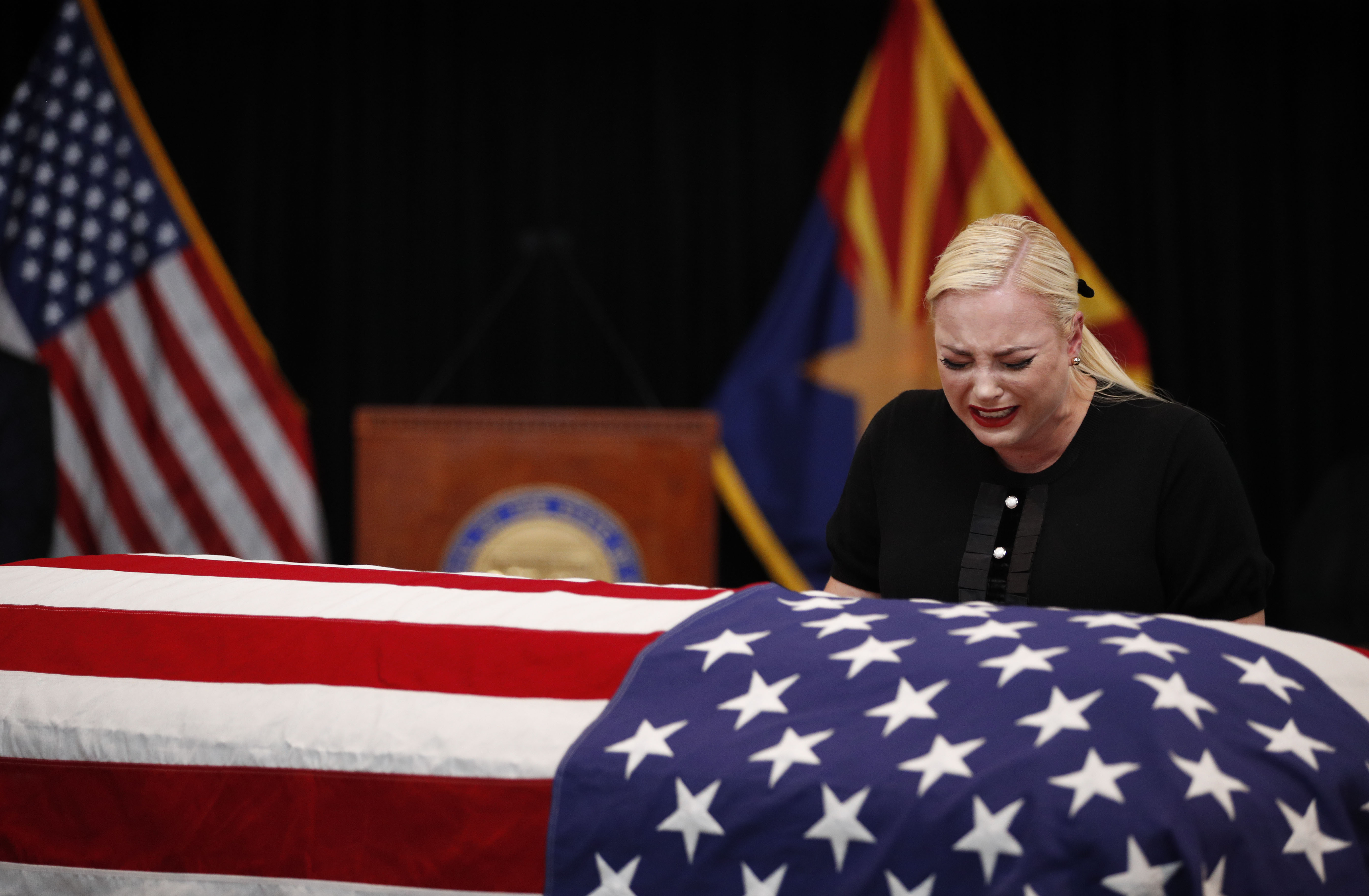 Meghan McCain, daughter of Sen. John McCain, touches the casket during a memorial service at the Arizona Capitol on August 29, 2018, in Phoenix, Arizona. John McCain will lie in state at the Arizona State Capitol before being transported to Washington D.C. where he will be buried at the U.S. Naval Academy Cemetery in Annapolis. Sen. McCain, a decorated war hero, died August 25 at the age of 81 after a long battle with Glioblastoma, a form of brain cancer.