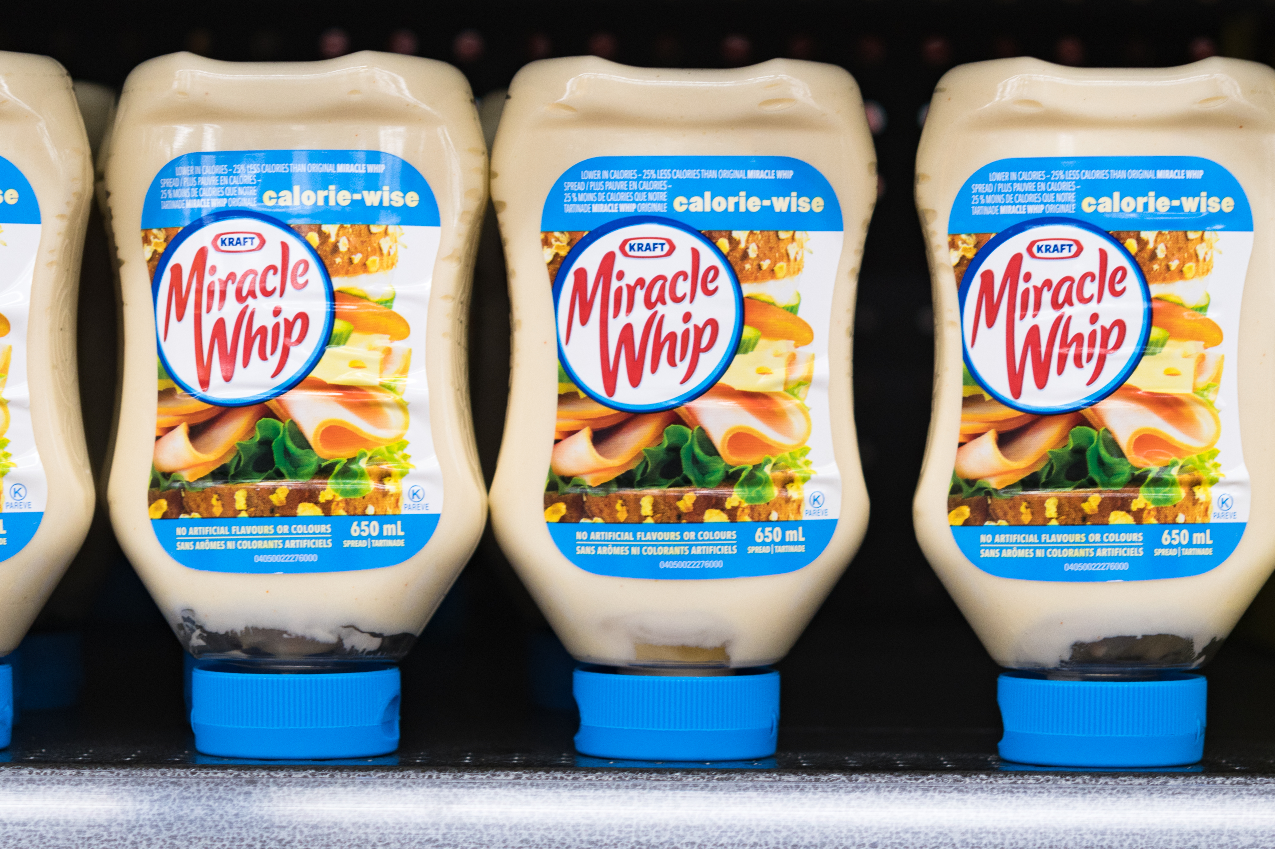 TORONTO, ONTARIO, CANADA - 2017/09/13: Kraft Miracle Whip on a store shelf, salad dressing bottles placed upside down in a row. (Photo by Roberto Machado Noa/LightRocket via Getty Images)