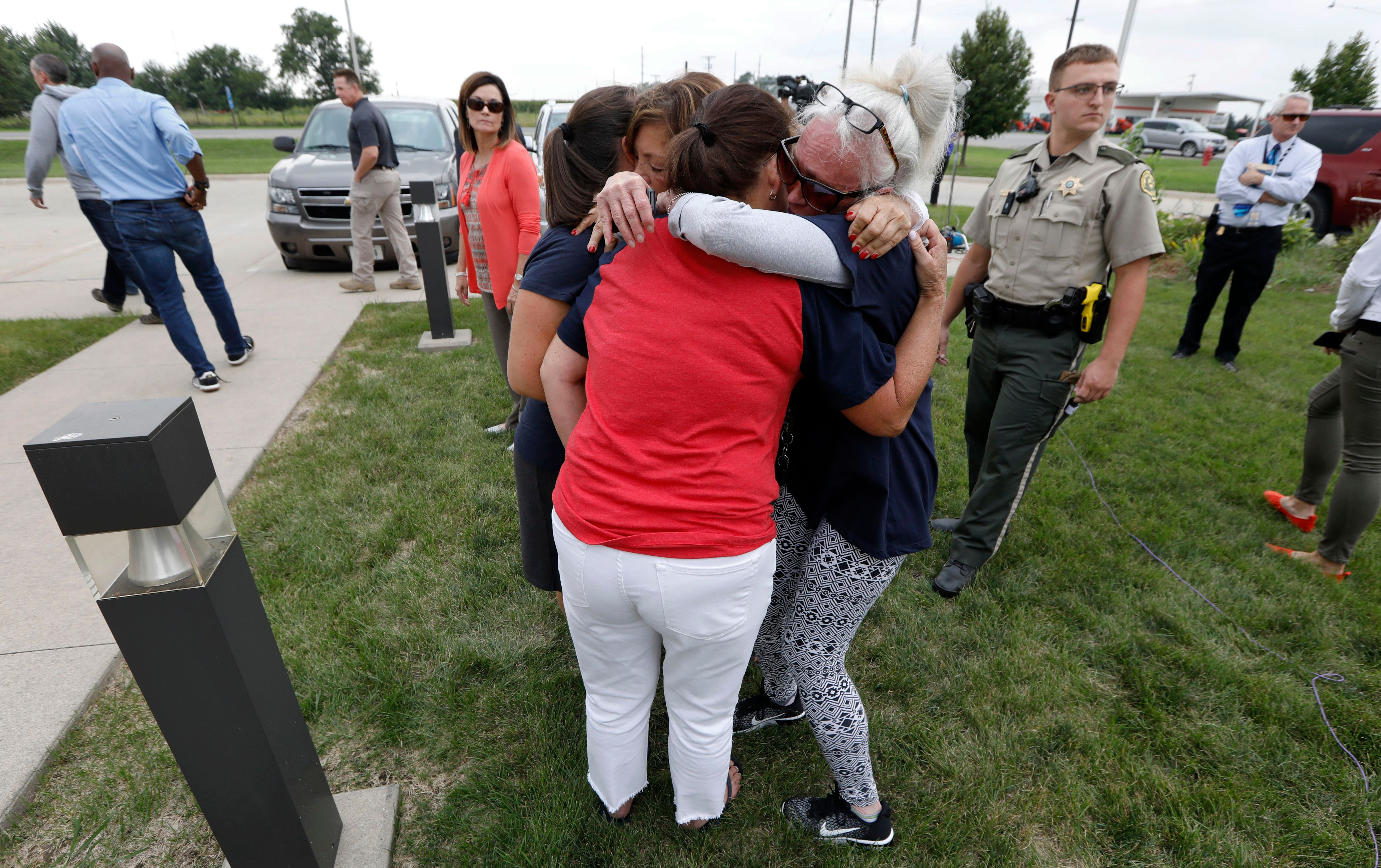 Friends and family of then-missing University of Iowa student Mollie Tibbetts react following a news conference, in Montezuma, Iowa, on Aug. 21, 2018. A funeral service for Tibbetts was held on Sunday.