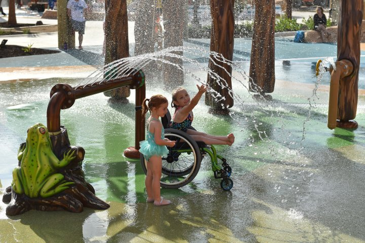 Children play in a water fountain at Morgan's Inspiration Island in San Antonio