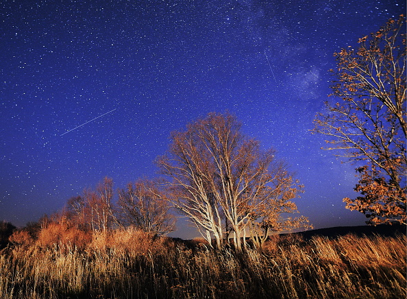 Meteors streak across the night sky during the Orionid meteor shower on Oct. 23, 2016.