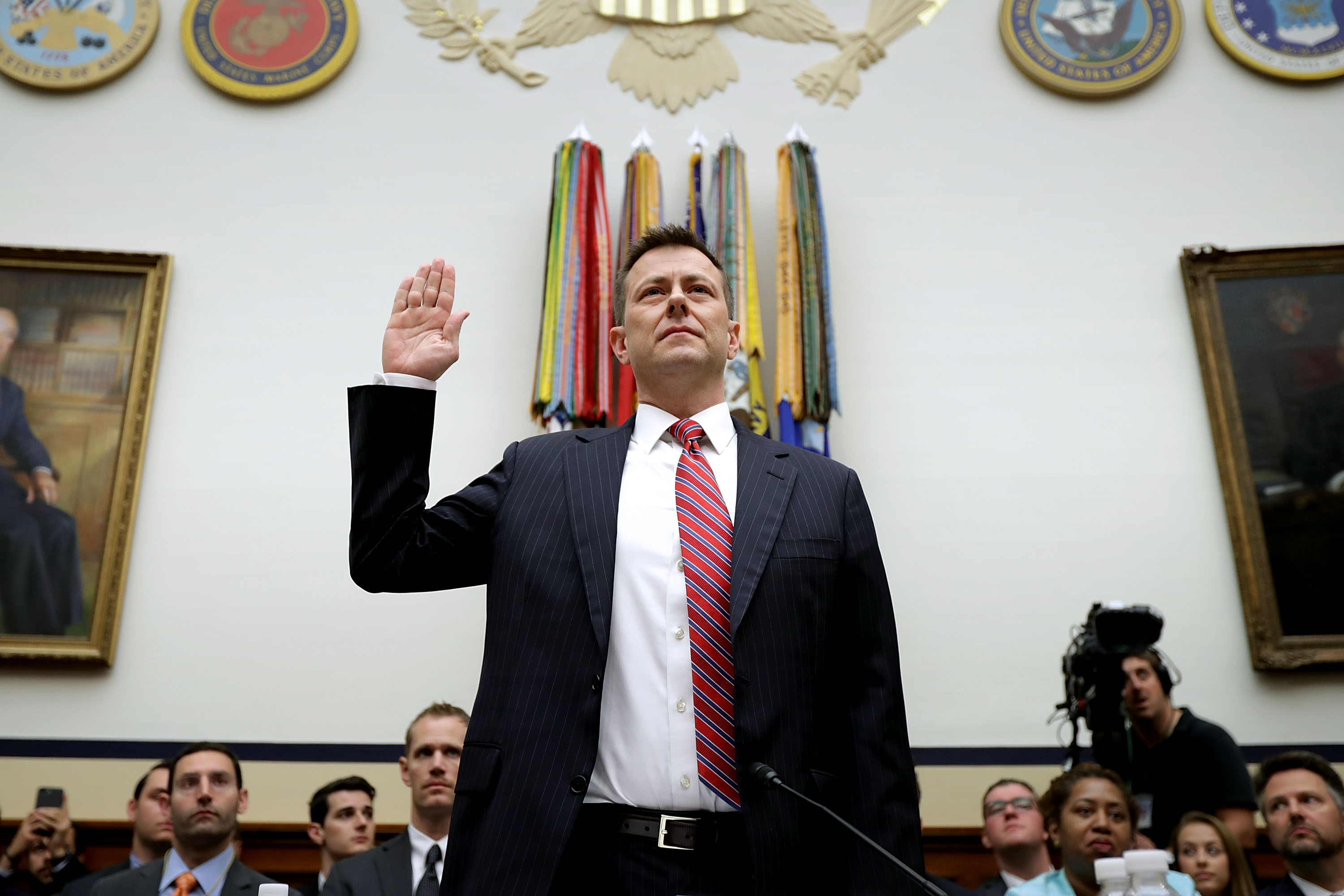 In this file photo, then-Deputy Assistant FBI Director Peter Strzok is sworn in before a joint committee hearing of the House Judiciary and Oversight and Government Reform committees in the Rayburn House Office Building on Capitol Hill July 12, 2018 in Washington, D.C. Strzok was fired from his post on Monday.
