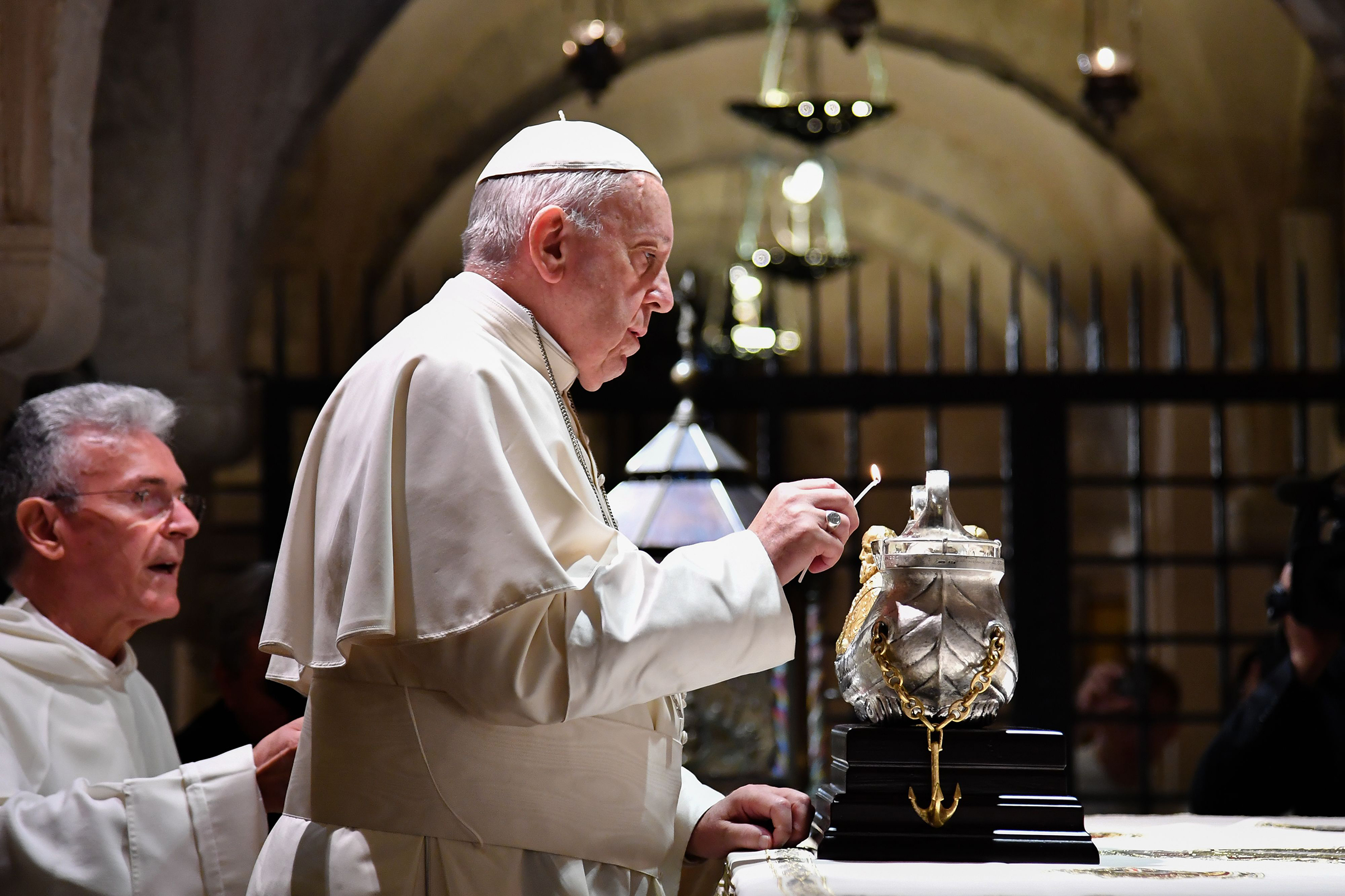 Pope Francis lights the uniflamma lamp at the tomb of Saint Nicholas in Pontifical Basilica of St Nicholas in Bari, Italy, on July 7, 2018.