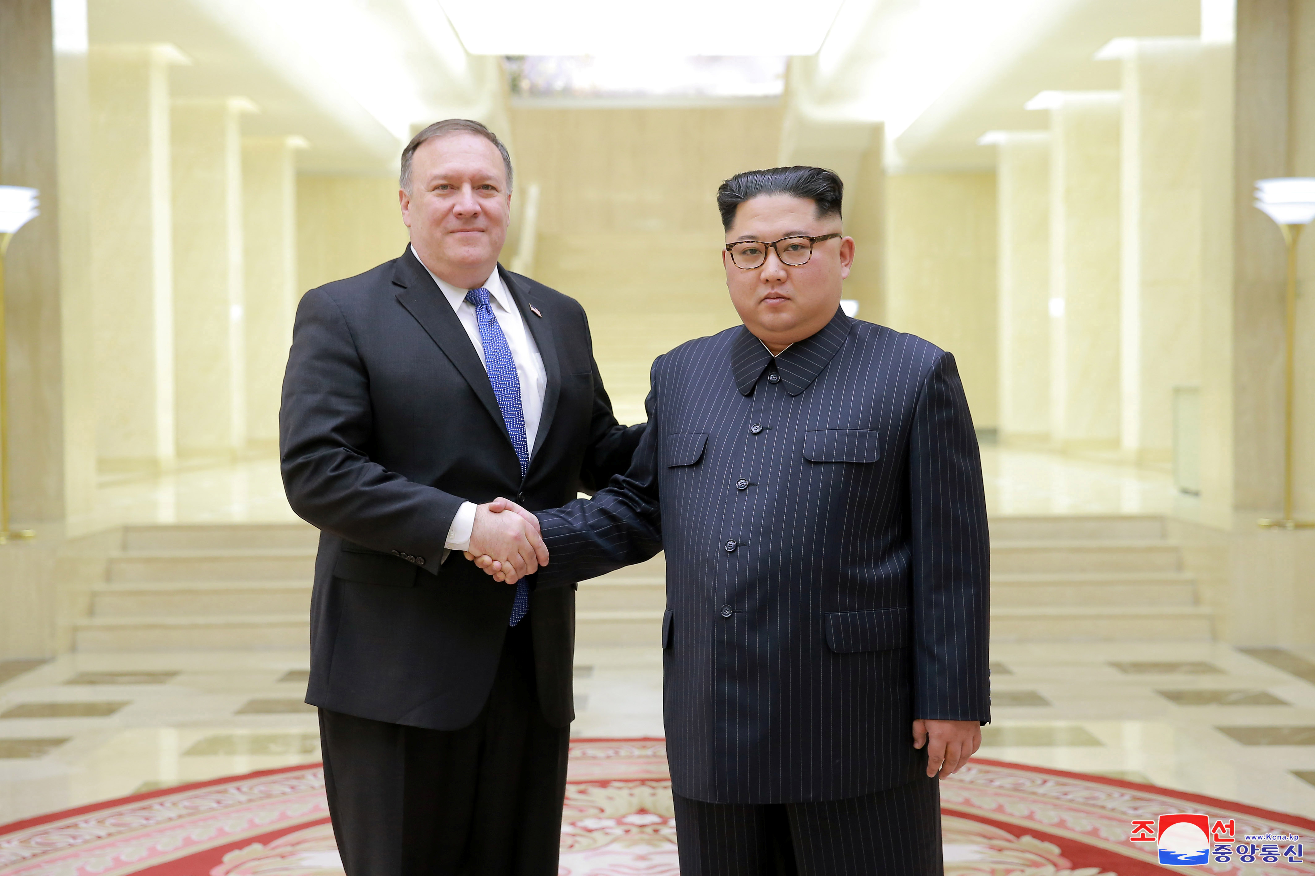 North Korean leader Kim Jong Un shakes hands with U.S. Secretary of State Mike Pompeo in this undated photo released on May 9, 2018 by North Korea's Korean Central News Agency (KCNA) in Pyongyang.