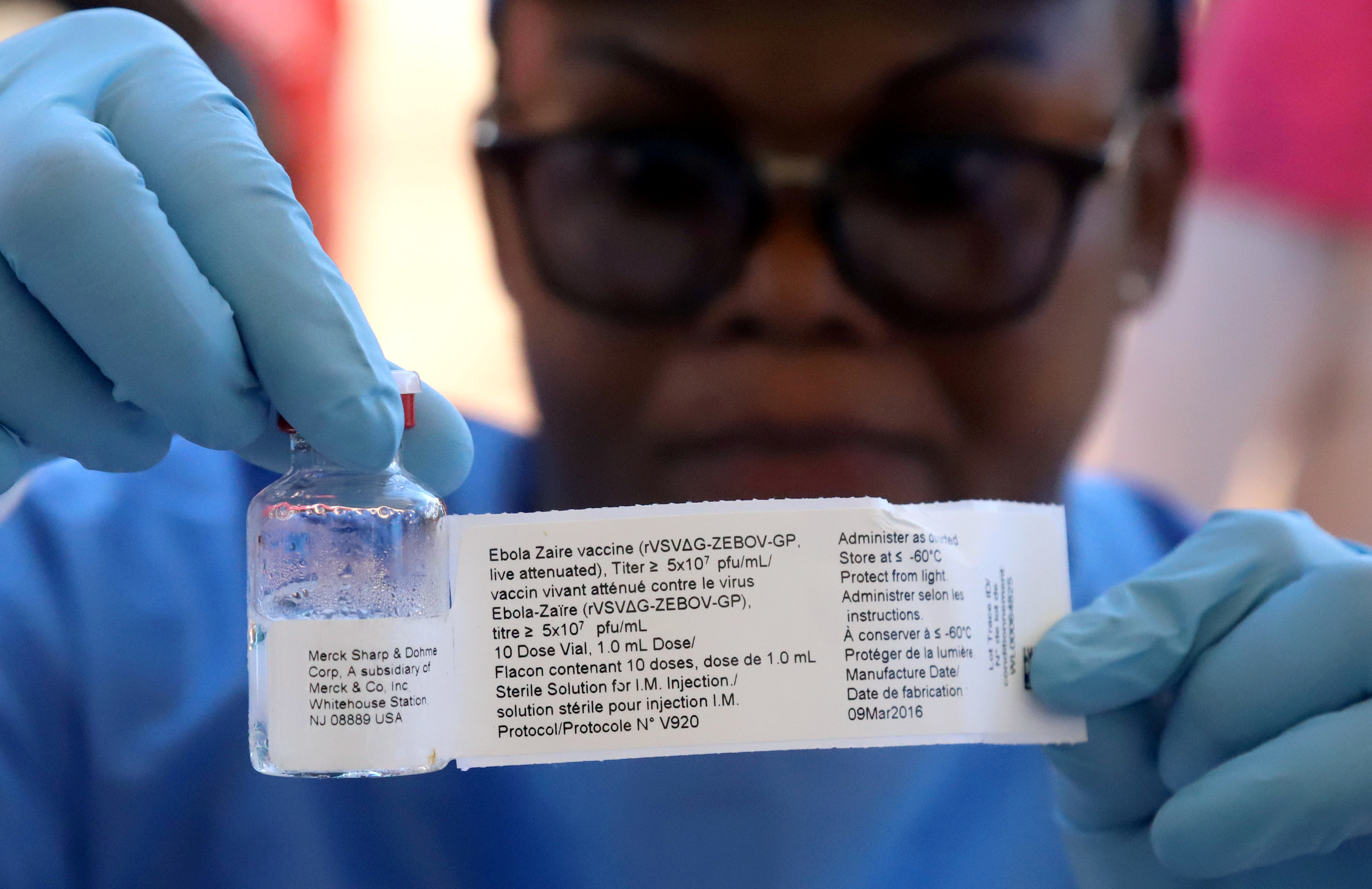A World Health Organization (WHO) worker prepares to administer a vaccination during an outbreak of Ebola in the port city of Mbandaka, Democratic Republic of Congo, on May 21, 2018.