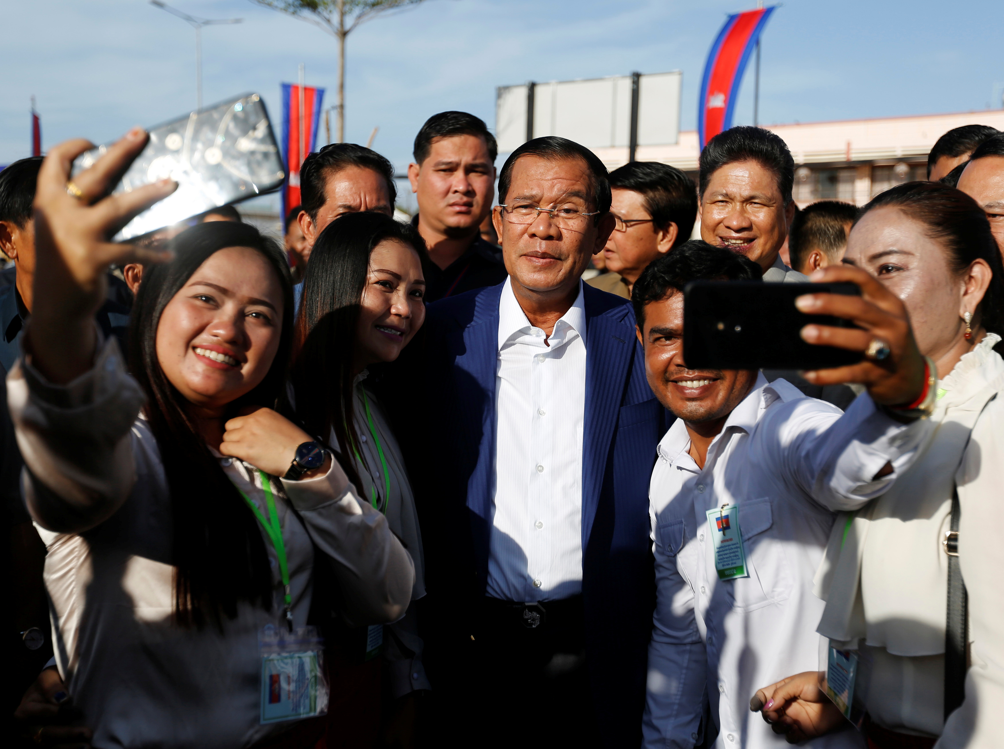 Supporters take pictures with Cambodia's Prime Minister Hun Sen at the inauguration of a new boat terminal in Phnom Penh on Aug. 1, 2018.