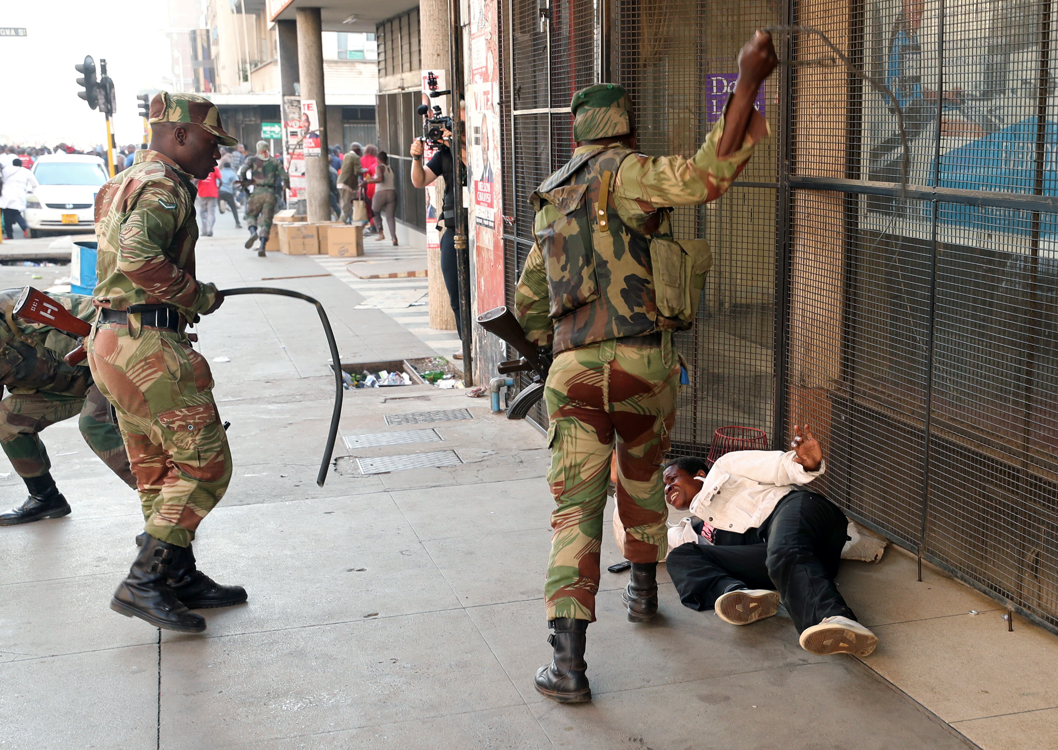 Soldiers beat a supporter of the opposition Movement for Democratic Change outside the party's headquarters in Harare, Zimbabwe on Aug. 1, 2018.
