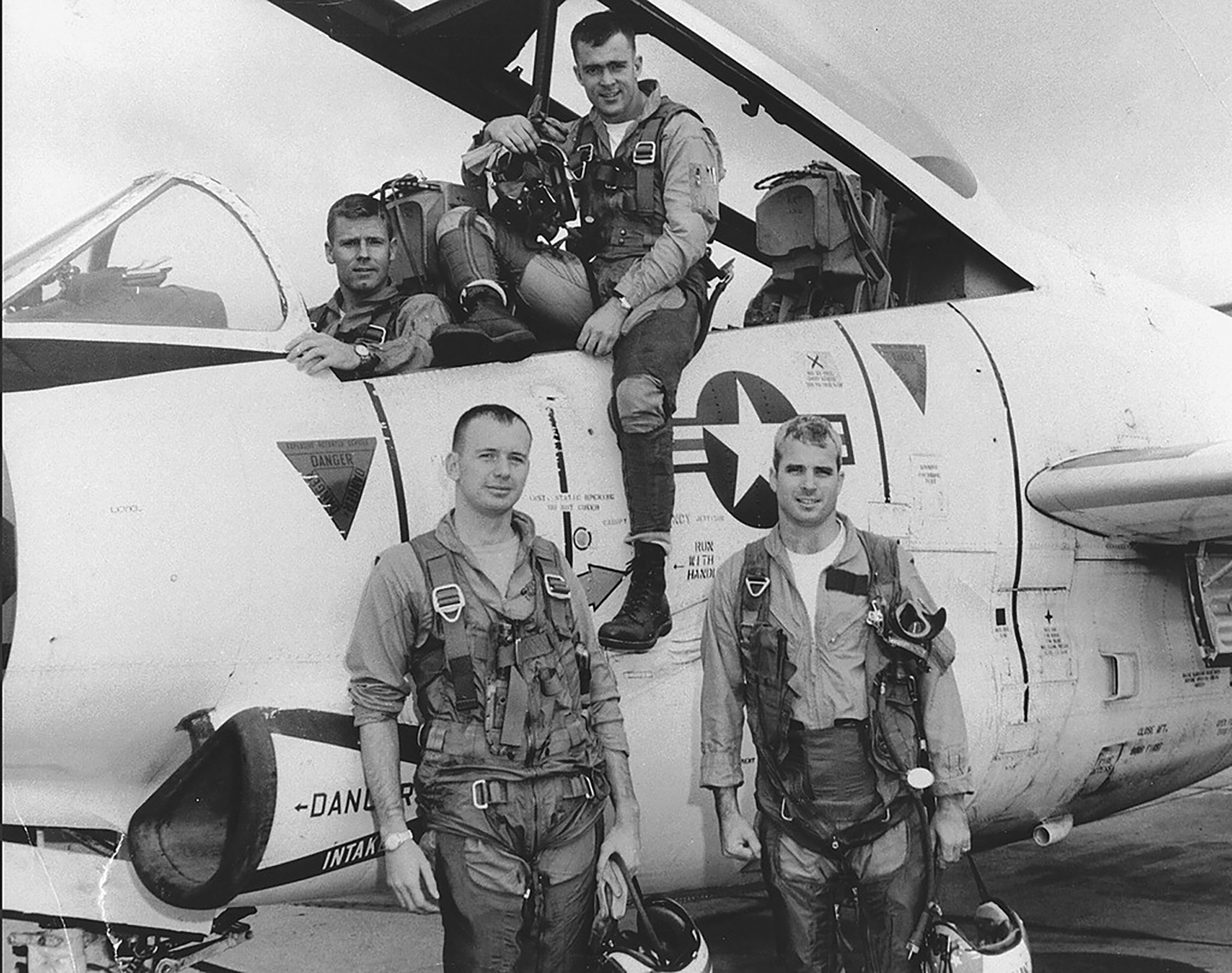 John McCain, (front, right) with his squadron in 1965.