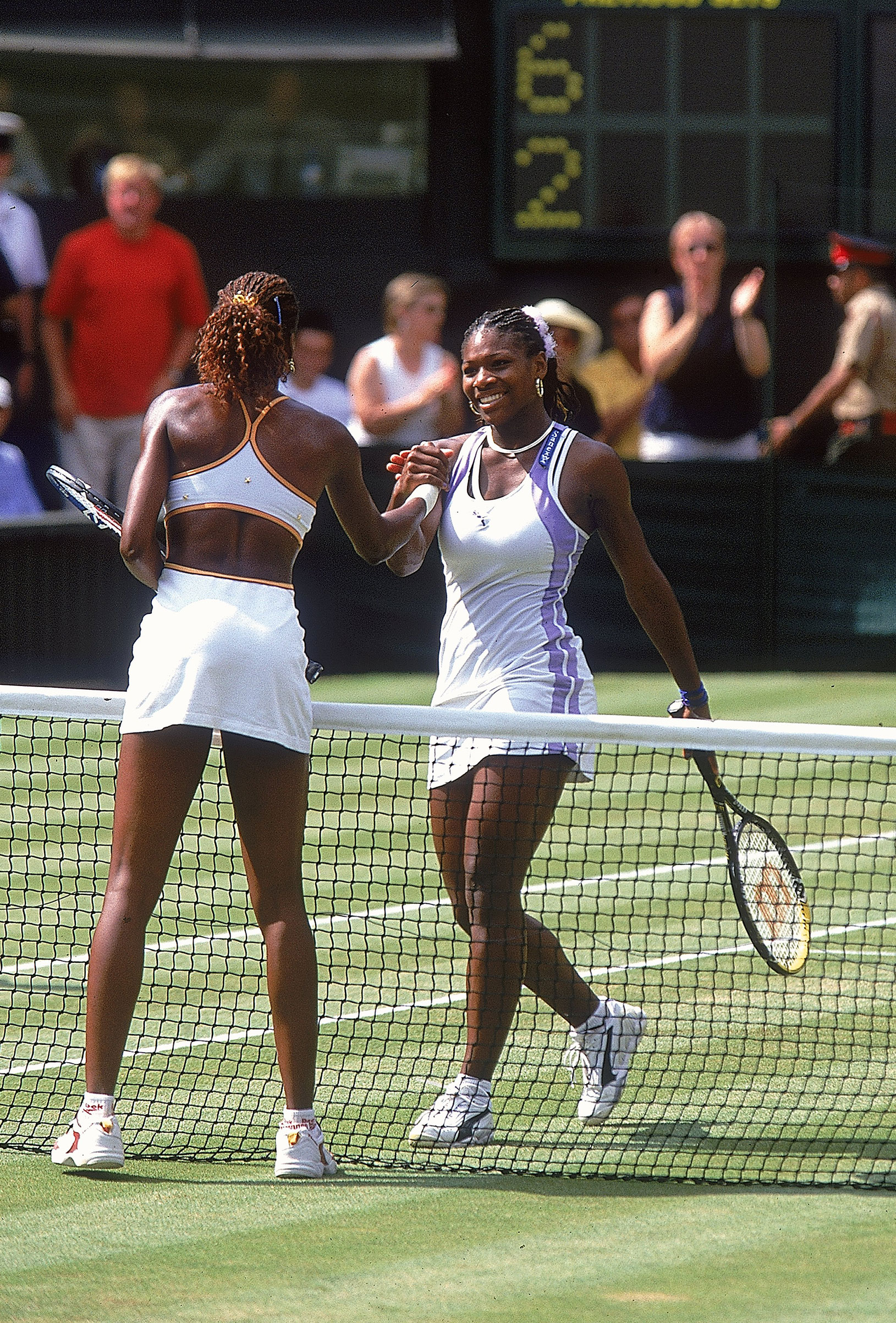 Serena Williams of the USA congratulates her sister Venus after losing to her in the womens semi final at the Wimbledon Lawn Tennis Championship at the All England Lawn Tennis and Croquet Club, Wimbledon, London on Jul 6, 2000.